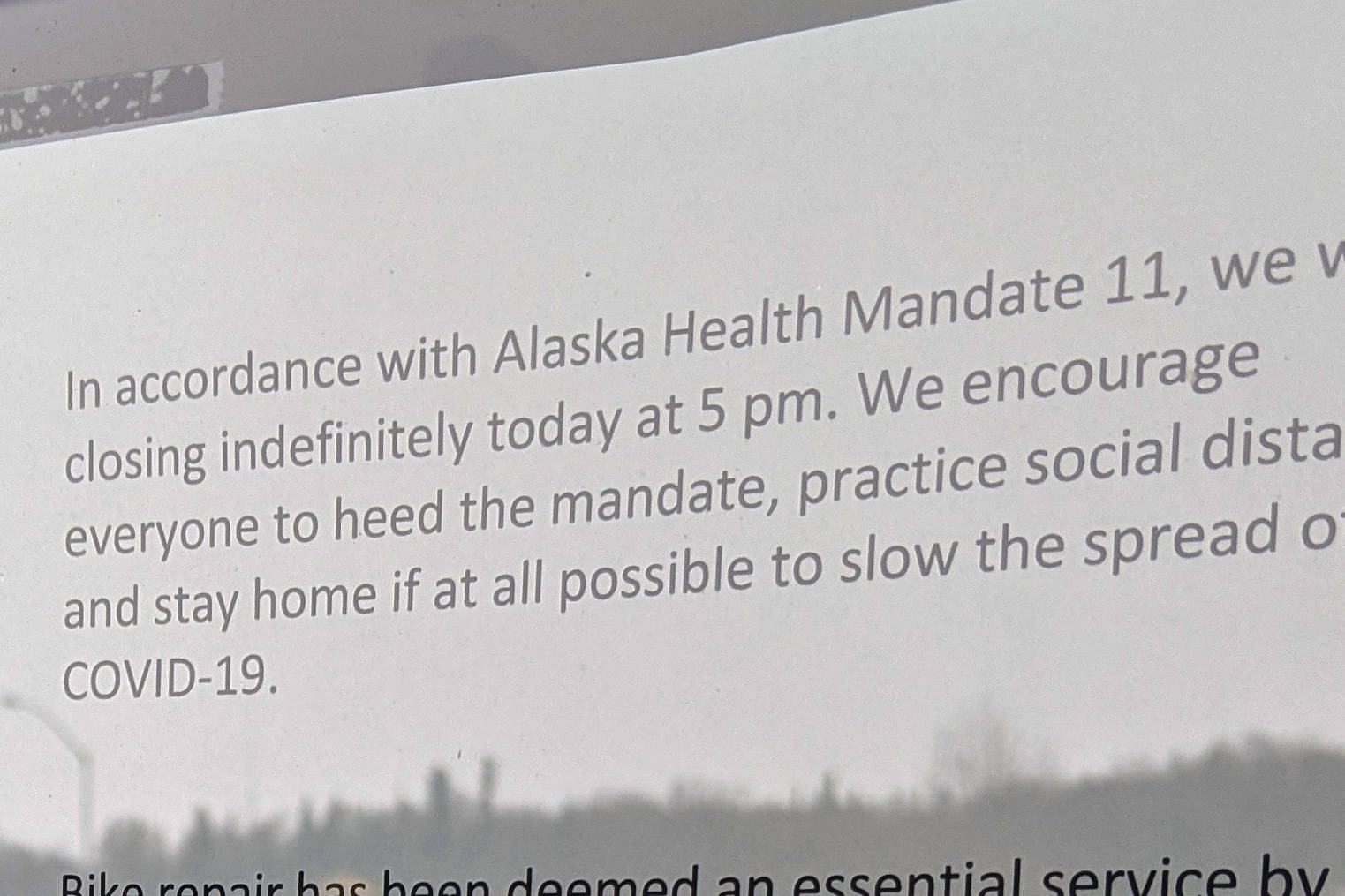 A sign notifying the public of closure of nonessential businesses due to public health mandate 11 can be seen in Soldotna, Alaska, on April 1, 2020. Gov. Mike Dunleavy issued guidelines allowing nonessential businesses to operate in a limited capacity on Wednesday, April 22, 2020. (Photo by Erin Thompson/Peninsula Clarion)
