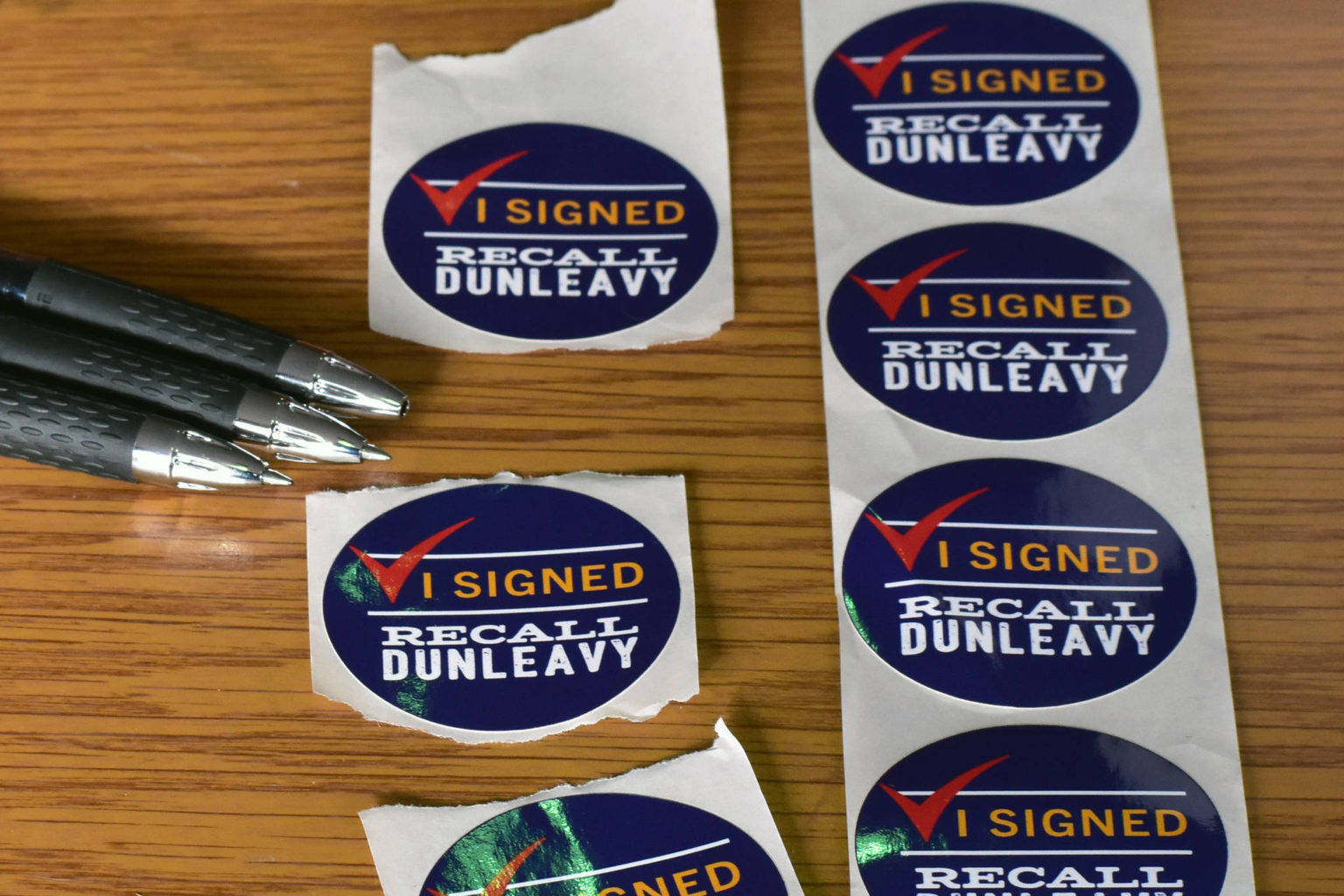 Juneauites gathered signatures to recall Gov. Mike Dunleavy in late February. (Peter Segall | Juneau Empire)