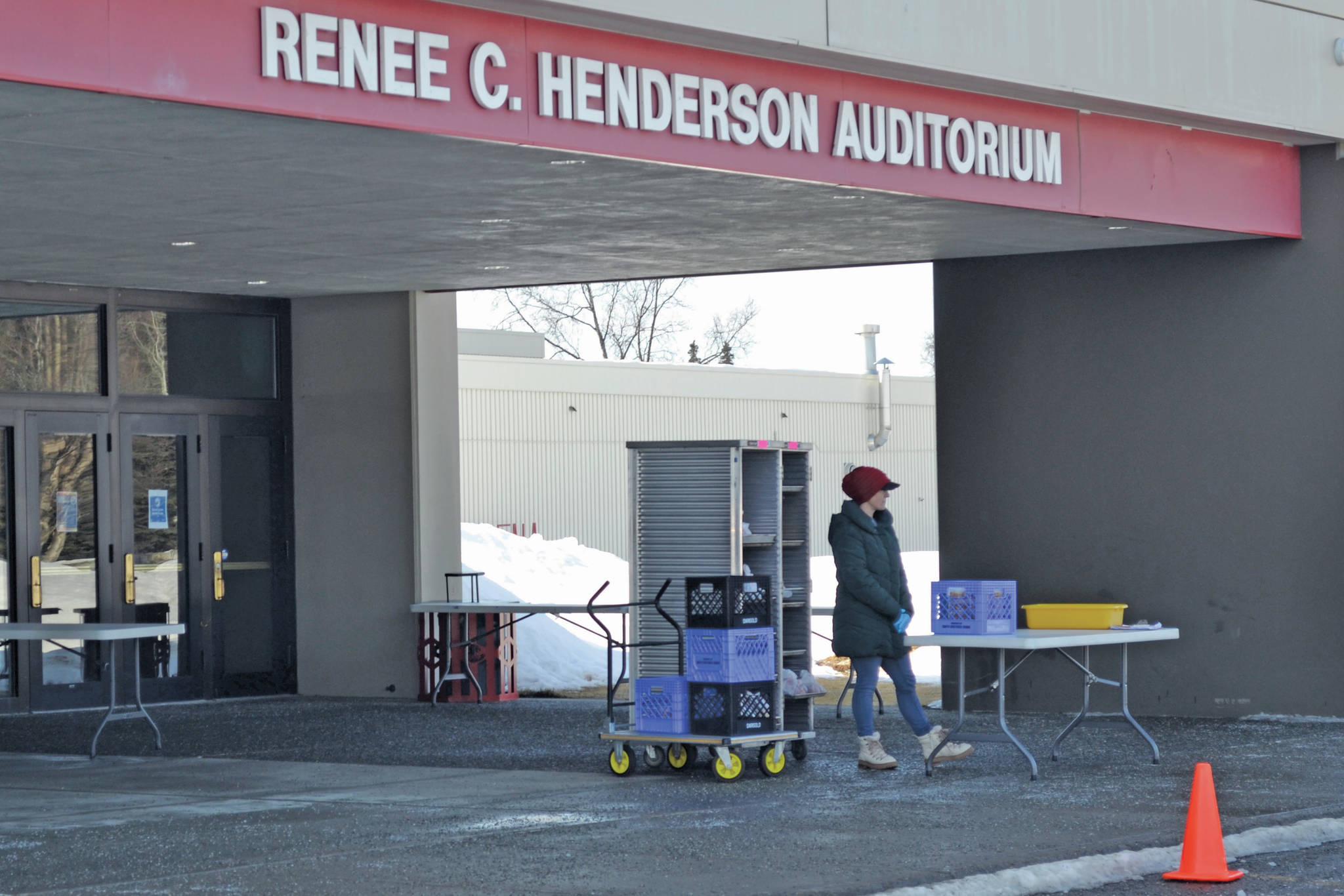 Kenai Peninsula Borough School District staff distribute student meal for lunch at Kenai Central High School on March 25, 2020, in Kenai, Alaska. (Photo by Victoria Petersen/Peninsula Clarion)