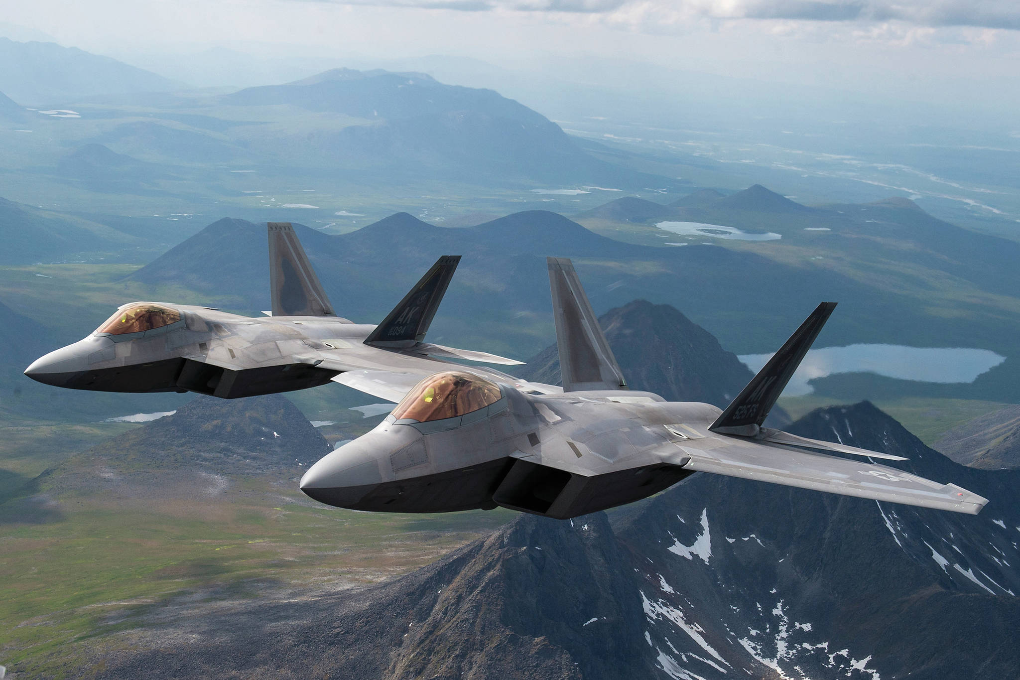 U.S. Air Force F-22 Raptors from Joint Base Elmendorf-Richardson, fly in formation over the Joint Pacific Alaska Range Complex on July 18, 2019. (U.S. Air Force photo by Staff Sgt. James Richardson)