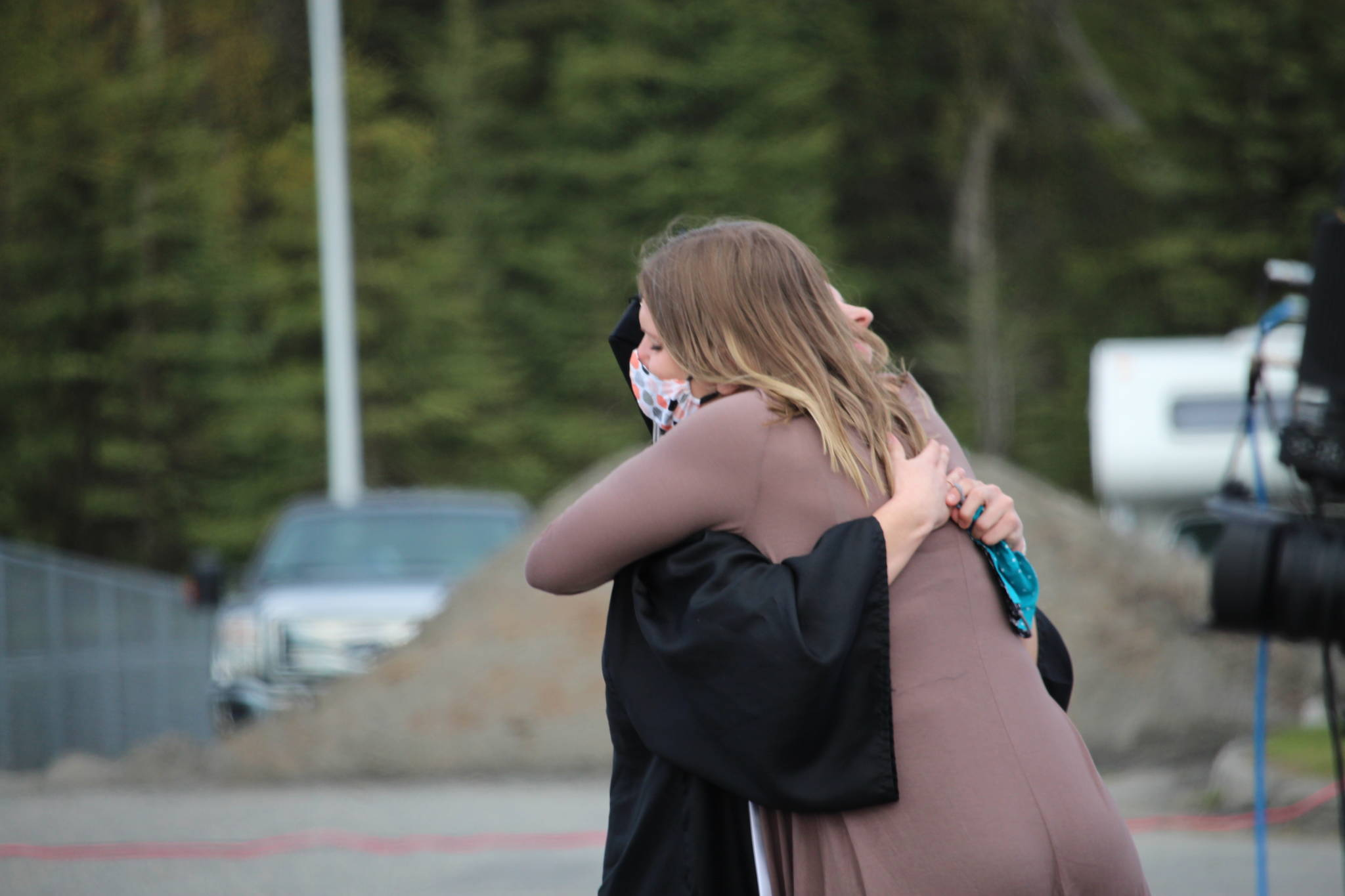 Class valedictorian America Jeffreys hugs her mom after giving a speech during the 2020 Nikiski High School Graduation Commencement Ceremony in Nikiski, Alaska on May 19, 2020. (Photo by Brian Mazurek/Peninsula Clarion)