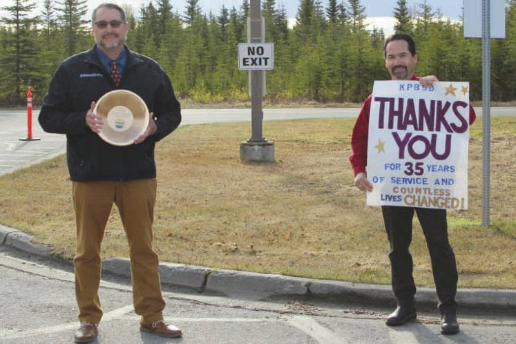 Mountain View Elementary teacher David Daniel is congratulated on his retirement by John O'Brien, Kenai Peninsula Borough School District superintendent, Tuesday, May 19, 2020, at Mountain View in Kenai. Daniel taught in the district for 34 years. (Photo courtesy of Karl Kircher)