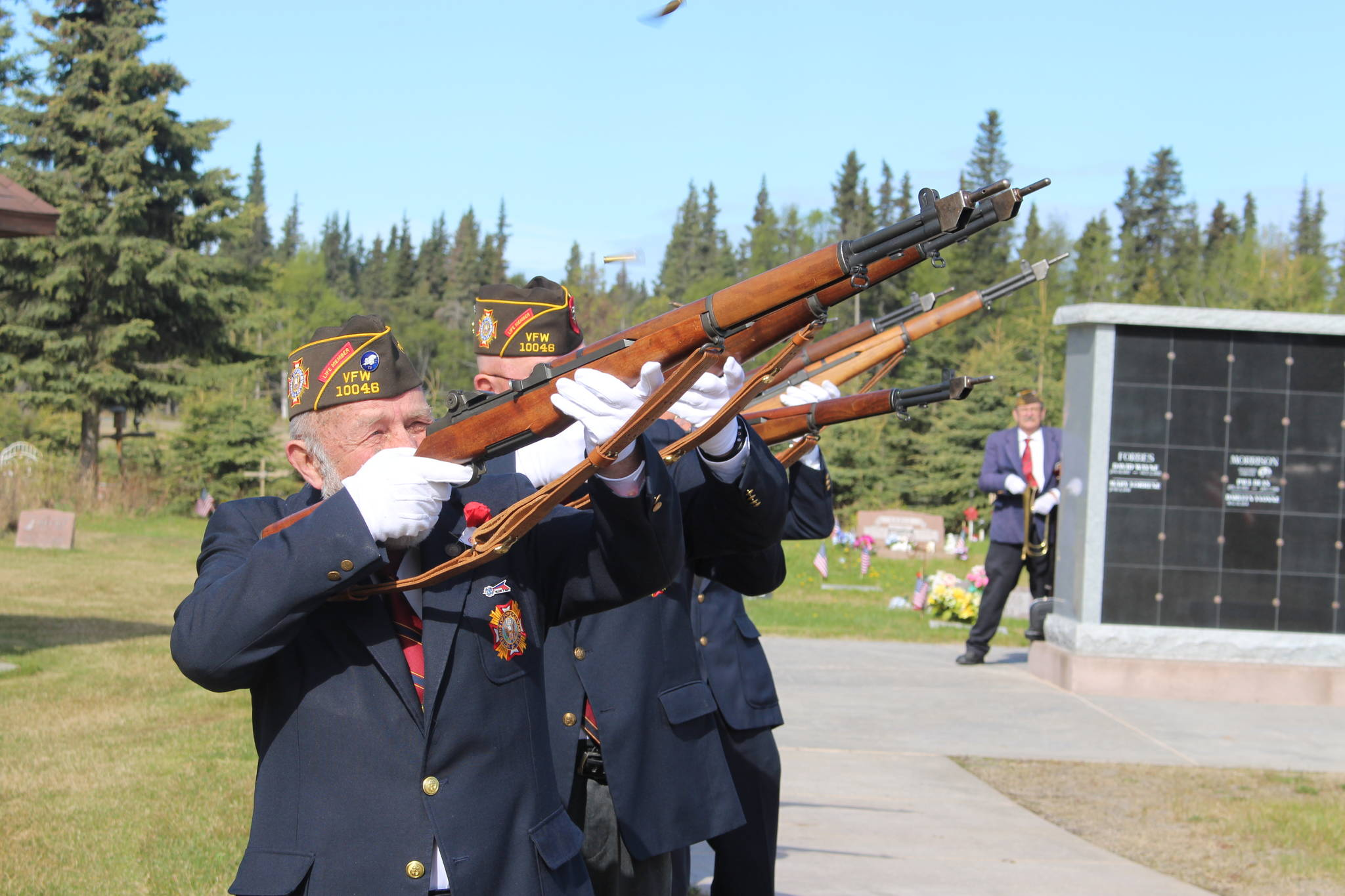 Kenai VFW Commander Mitch Johnson and members of the local VFW Honor Guard give a 21-gun salute during the Memorial Day ceremony at the Kenai Cemetery on May 25, 2020. (Photo by Brian Mazurek/Peninsula Clarion)