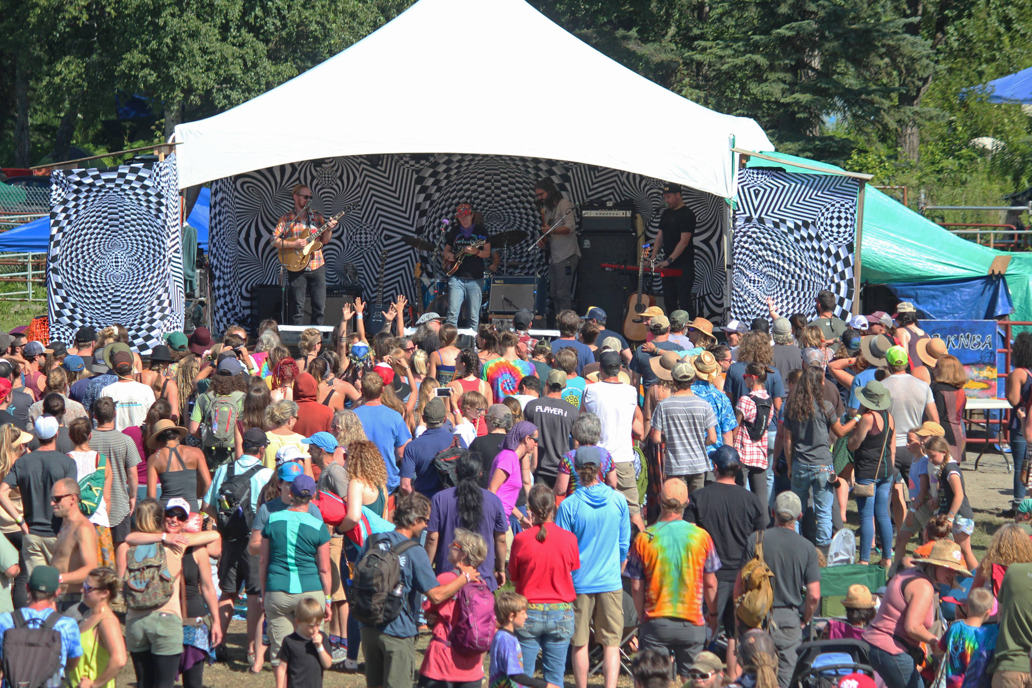 Photos by Megan Pacer / Homer News                                 Music lovers listen to a performance on the River Stage at Salmonfest on Aug. 4, 2018, in Ninilchik.