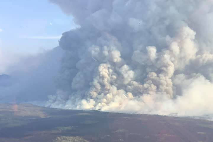 The Swan Lake Fire can be seen from above on Monday, Aug. 26 on the Kenai Peninsula, Alaska. (Photo courtesy Alaska Wildland Fire Information)