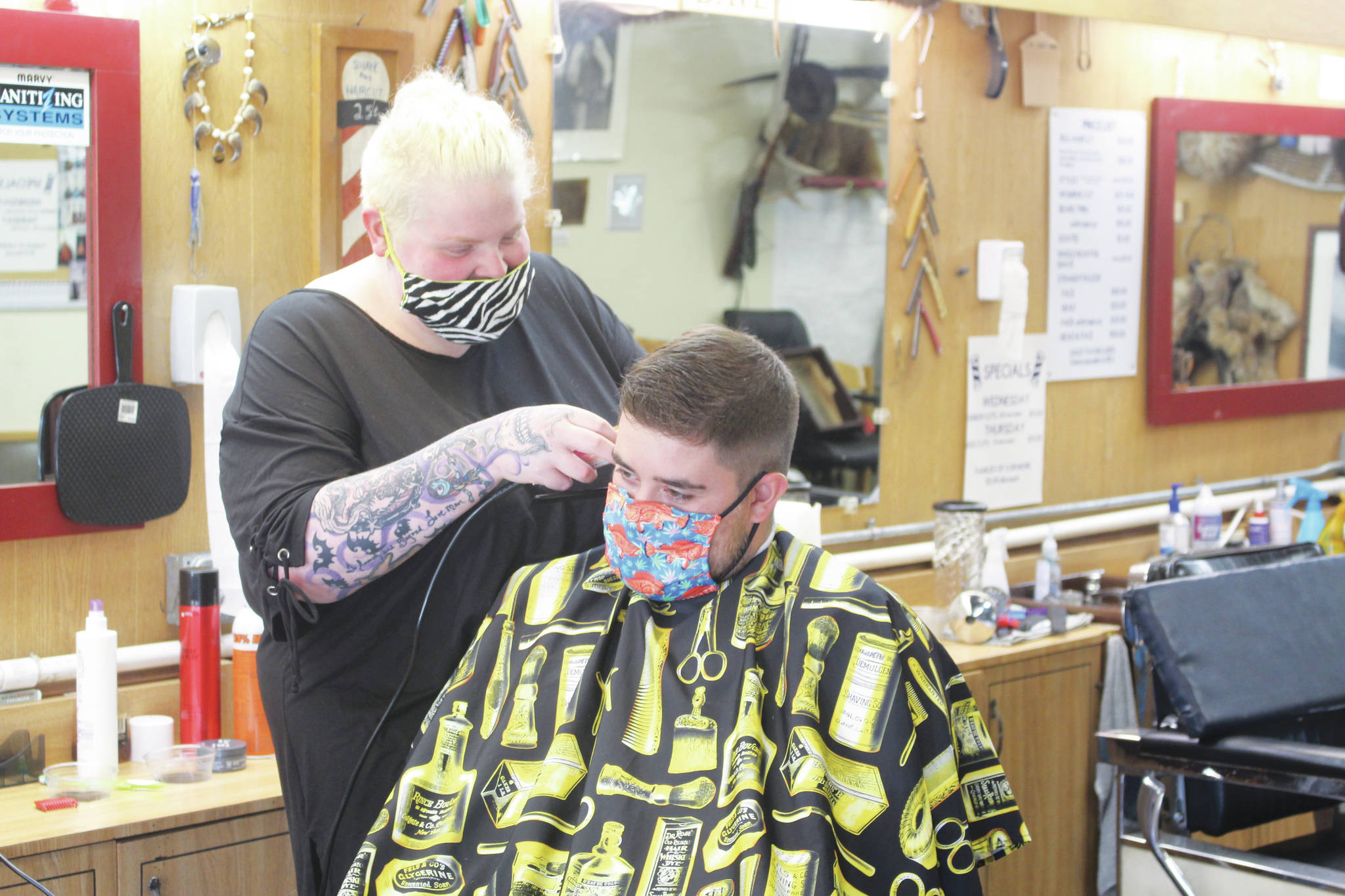 Photo by Brian Mazurek/Peninsula Clarion                                Skylar Giordano cuts Ryan Huerta's hair at RD's Barber Shop in Kena on Thursday. RD's is one of the 186 local businesses and nonprofits in Kenai that already received financial assistance through the City of Kenai's Grant Program.