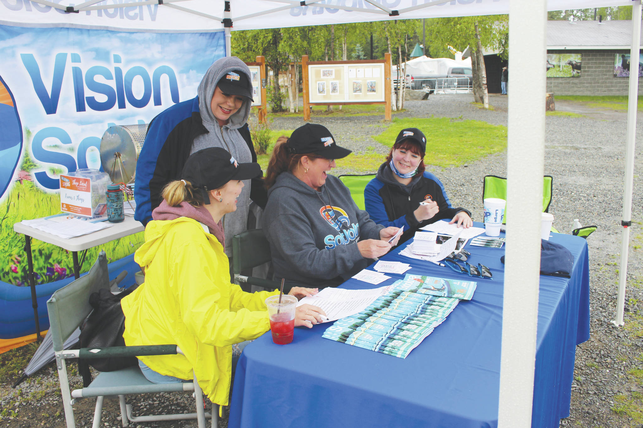 From left, Monique Burgin, Shanon Davis, Teresa Honrud and Sara Hondel of the Soldotna Chamber of Commerce on Wednesday add up the money spent as part of the Chamber's Soldotna Strong Shop Local campaign.