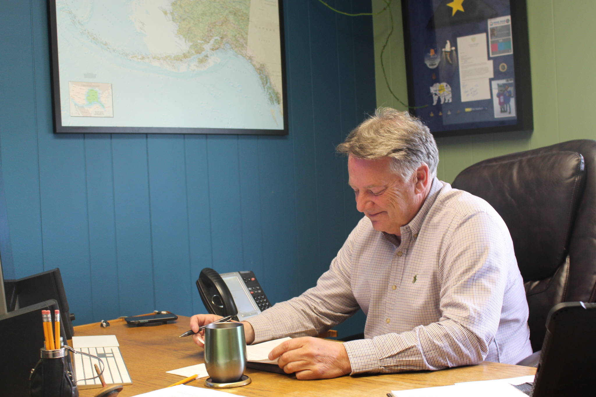 Tim Dillon, executive director of the Kenai Peninsula Economic Development District, is seen here reviewing his proposed changes to the Alaska Legislature regarding the AK CARES funds for small businesses at the KPEDD office in Kenai, Alaska, on July 1, 2020. (Photo by Brian Mazurek/Peninsula Clarion)