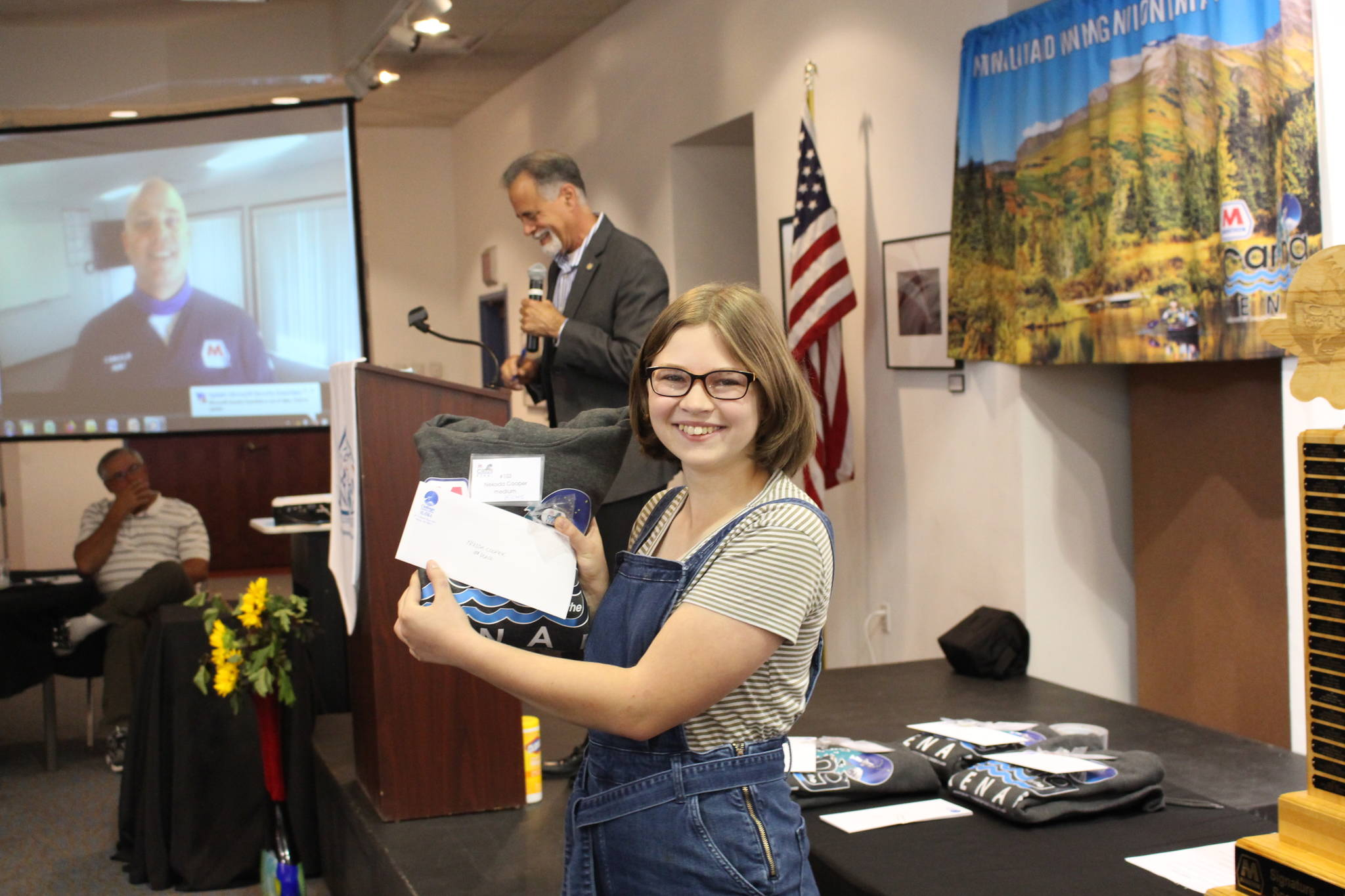 Nekoda Cooper smiles with her award for being a Caring for the Kenai Finalist during the Caring for the Kenai Awards Ceremony at the Kenai Visitor Center on Aug. 19, 2020. (Photo by Brian Mazurek/Peninsula Clarion)