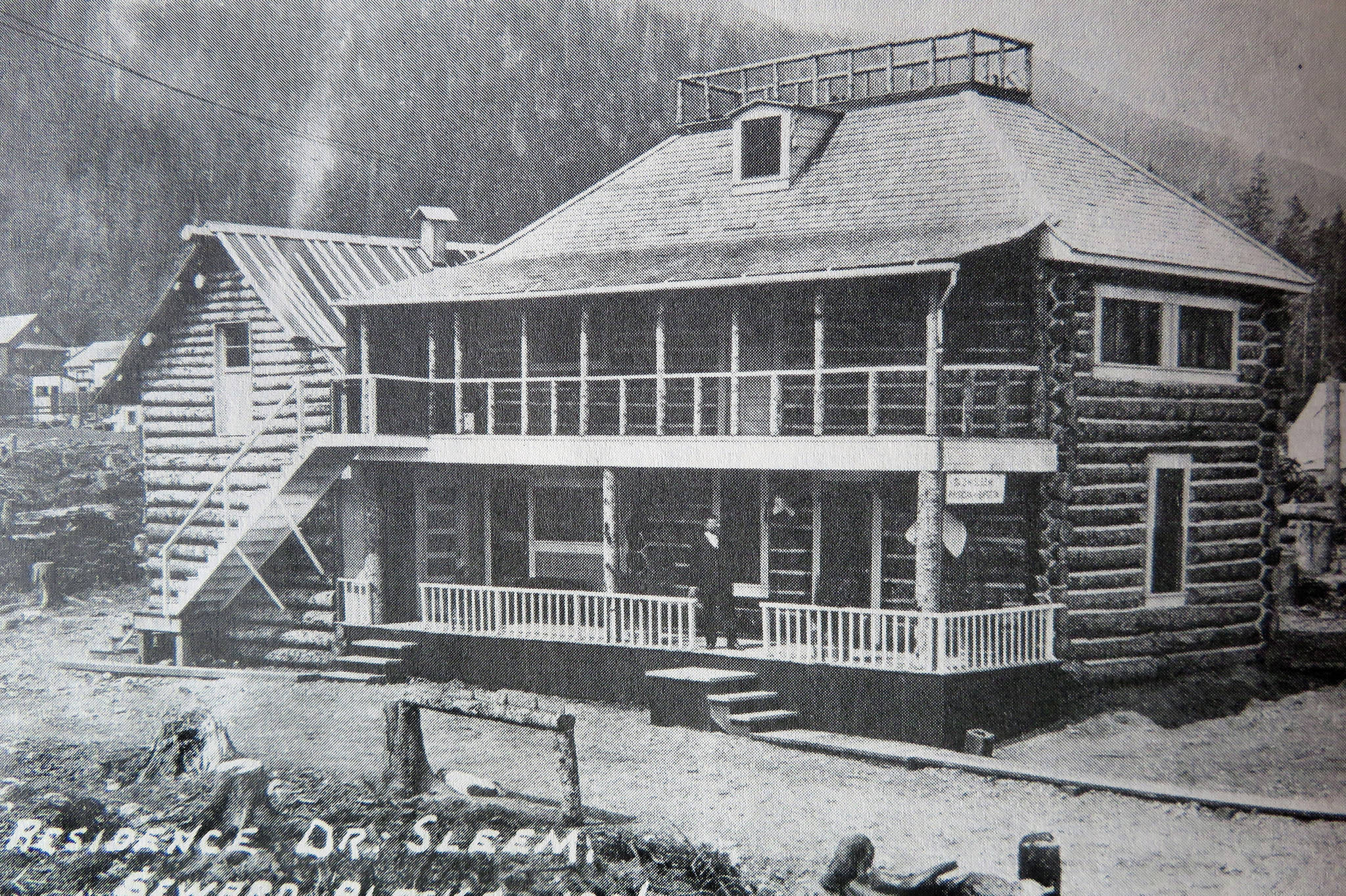 Anchorage Museum of History and Art                                Dr. David Hassan Sleem stands on the front porch of his large Seward home in 1906.