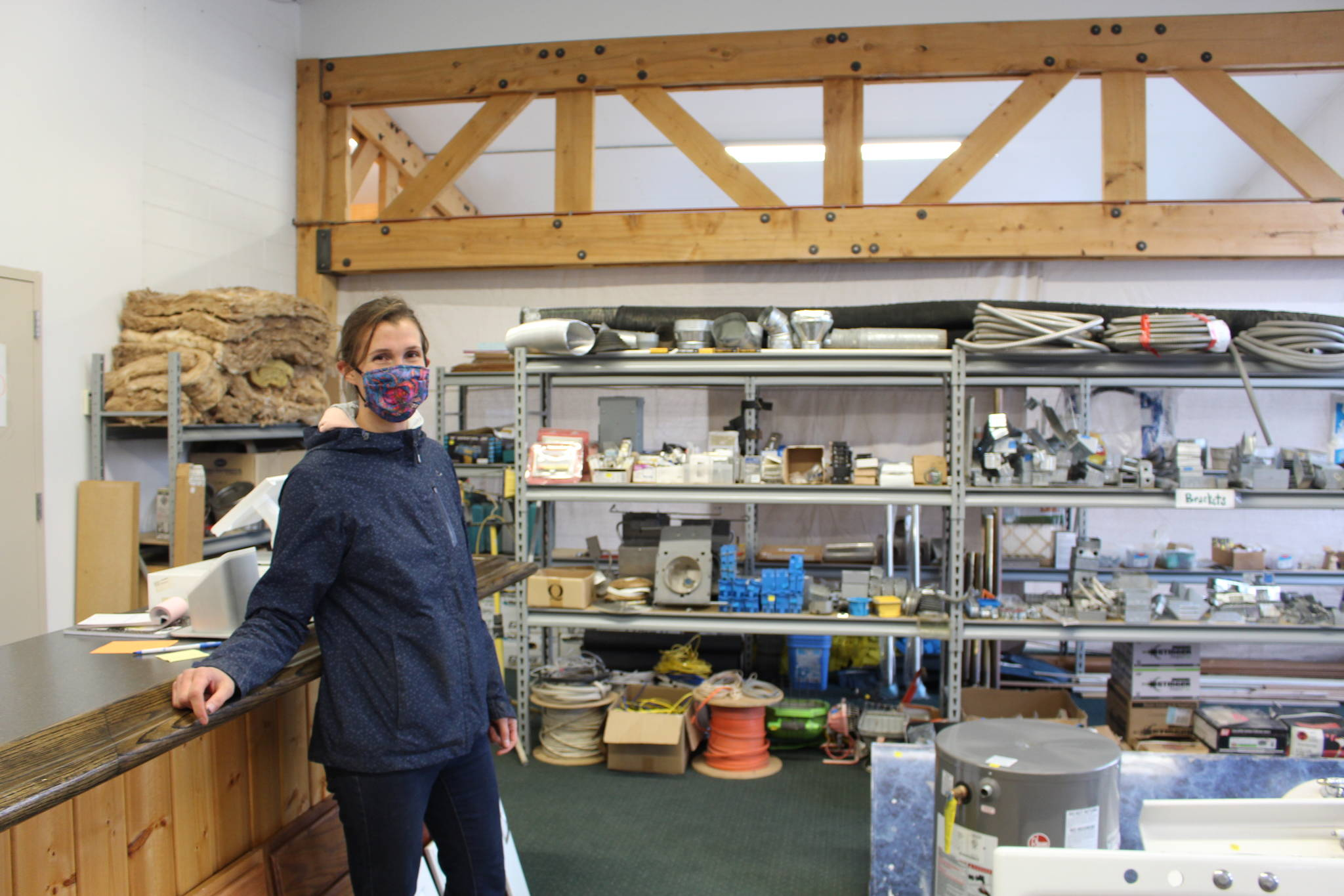 Amy Anderson, president and co-founder of BuildUP, a nonprofit thrift store for building materials, stands in the new BuildUP space that was leased thanks to the money donated by the Soldotna 100+ Women Who Care group on Sept. 24, 2020. (Photo by Brian Mazurek/Peninsula Clarion)