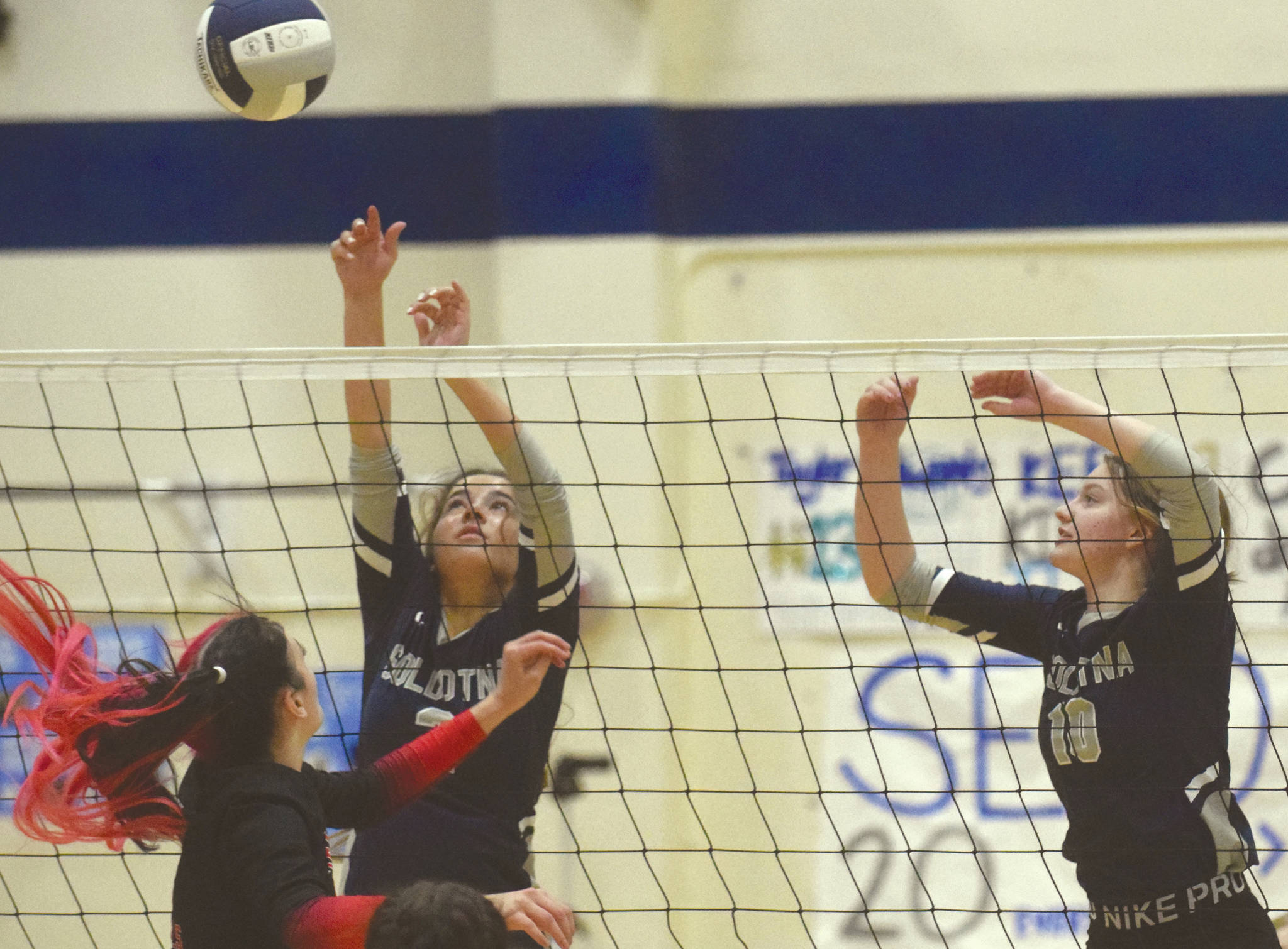 Soldotna's Sierra Kuntz and Bethany Richmond put up a block on Kenai Central's Andie Galloway on Friday, Sept. 25, 2020, at Soldotna High School in Soldotna, Alaska. (Photo by Jeff Helminiak/Peninsula Clarion)