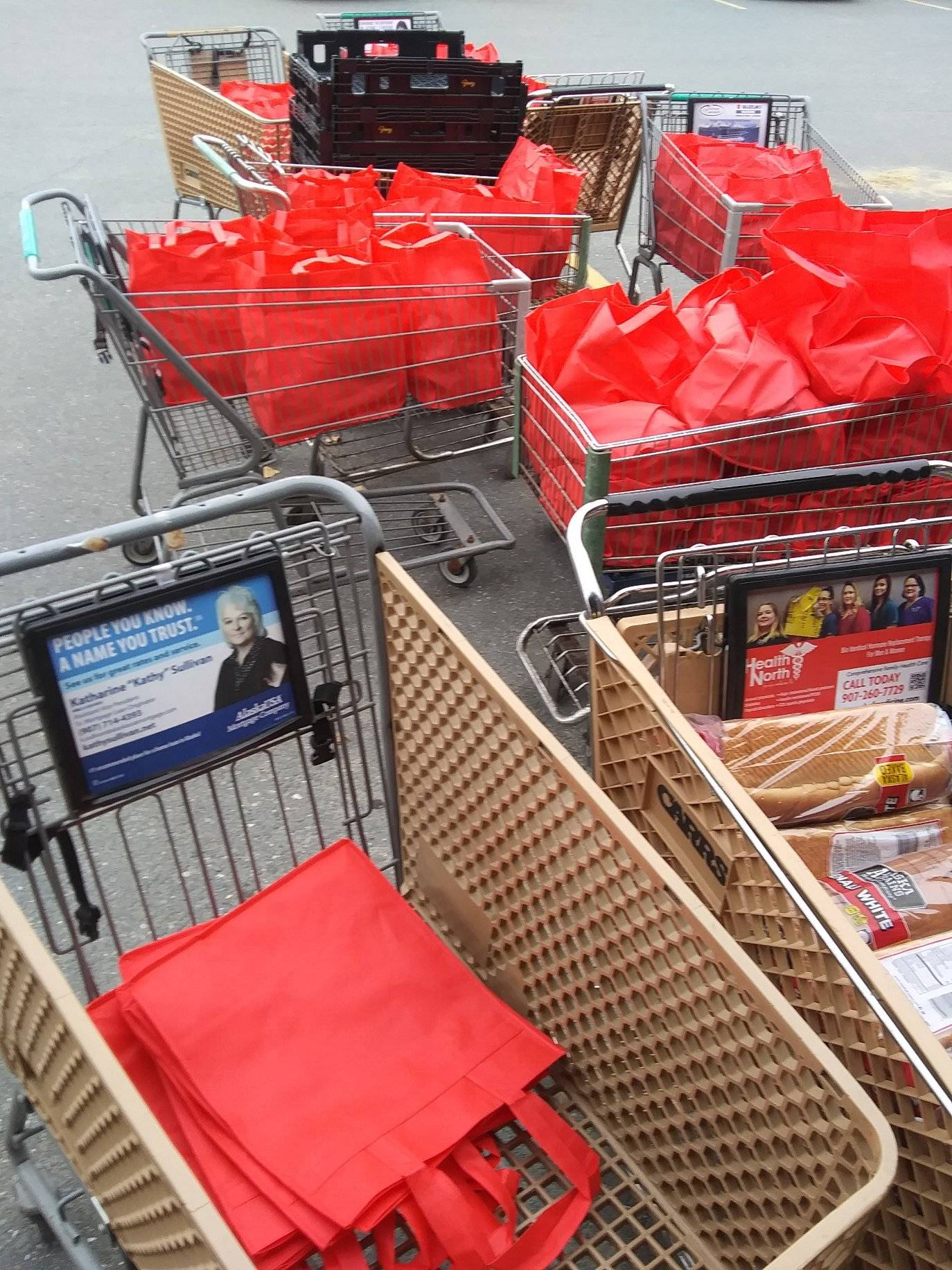 Shopping carts full of food bags for Soldotna residents are seen here outside Hospice of the Central Peninsula in Soldotna, Alaska on Oct. 8, 2020. (Photo courtesy Suzie Smalley)