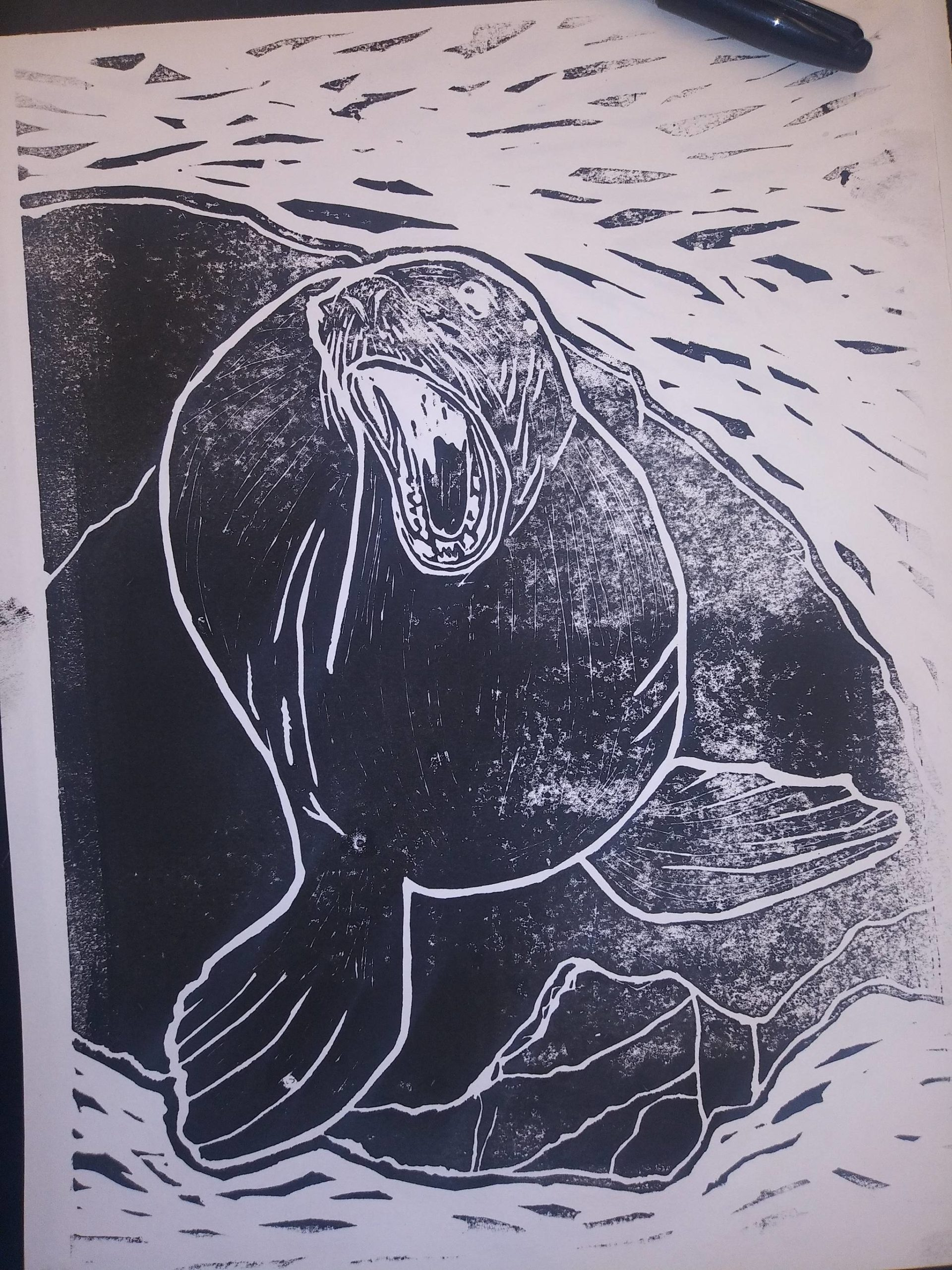 Linoleum prints made by Seward Middle and High School students are seen here in this undated photo. Anyone who brings in a receipt to one of three locations on the peninsula showing they donated $10 or more to the Alaska SeaLife Center in Seward gets to take home a print of their choice. (Photo courtesy Megan Wiley)