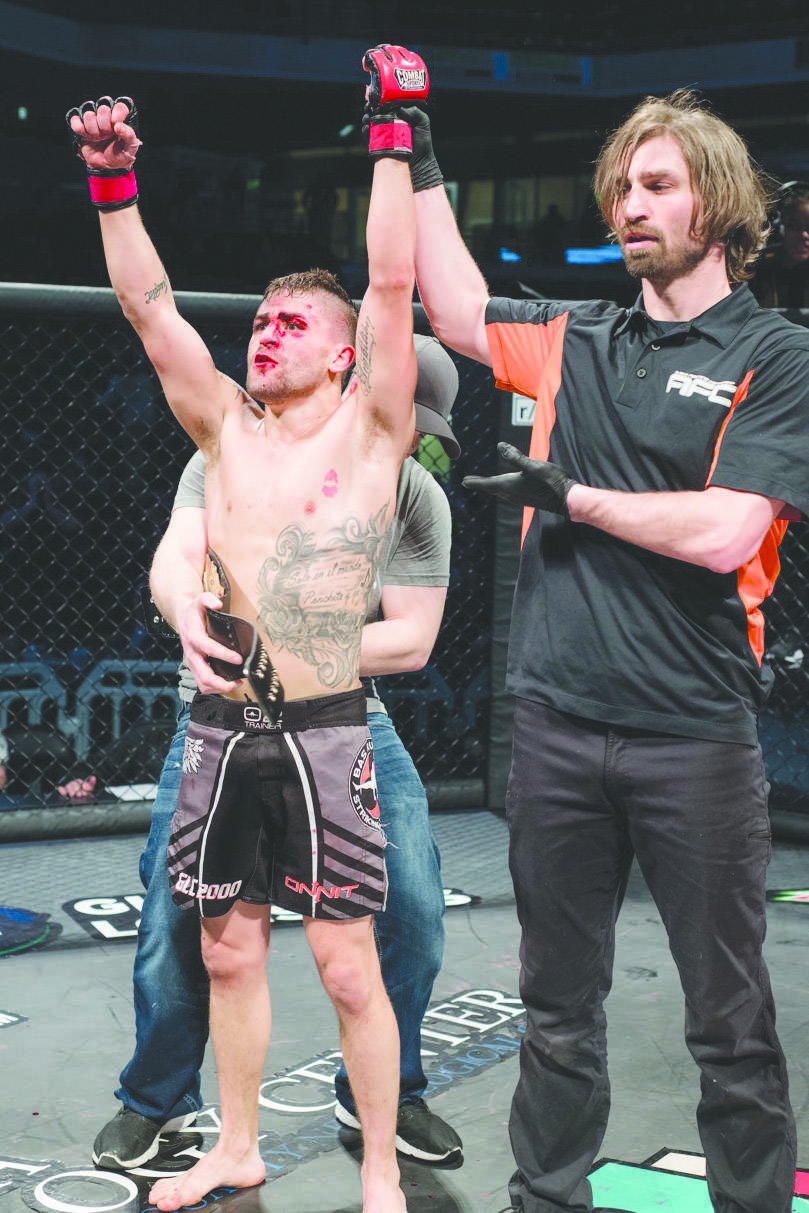 Photo courtesy of Maria Bundy Victor Rodriguez is awarded the Alaska Fighting Championship bantamweight title on Feb. 26, at the Alaska Airlines Center in Anchorage.