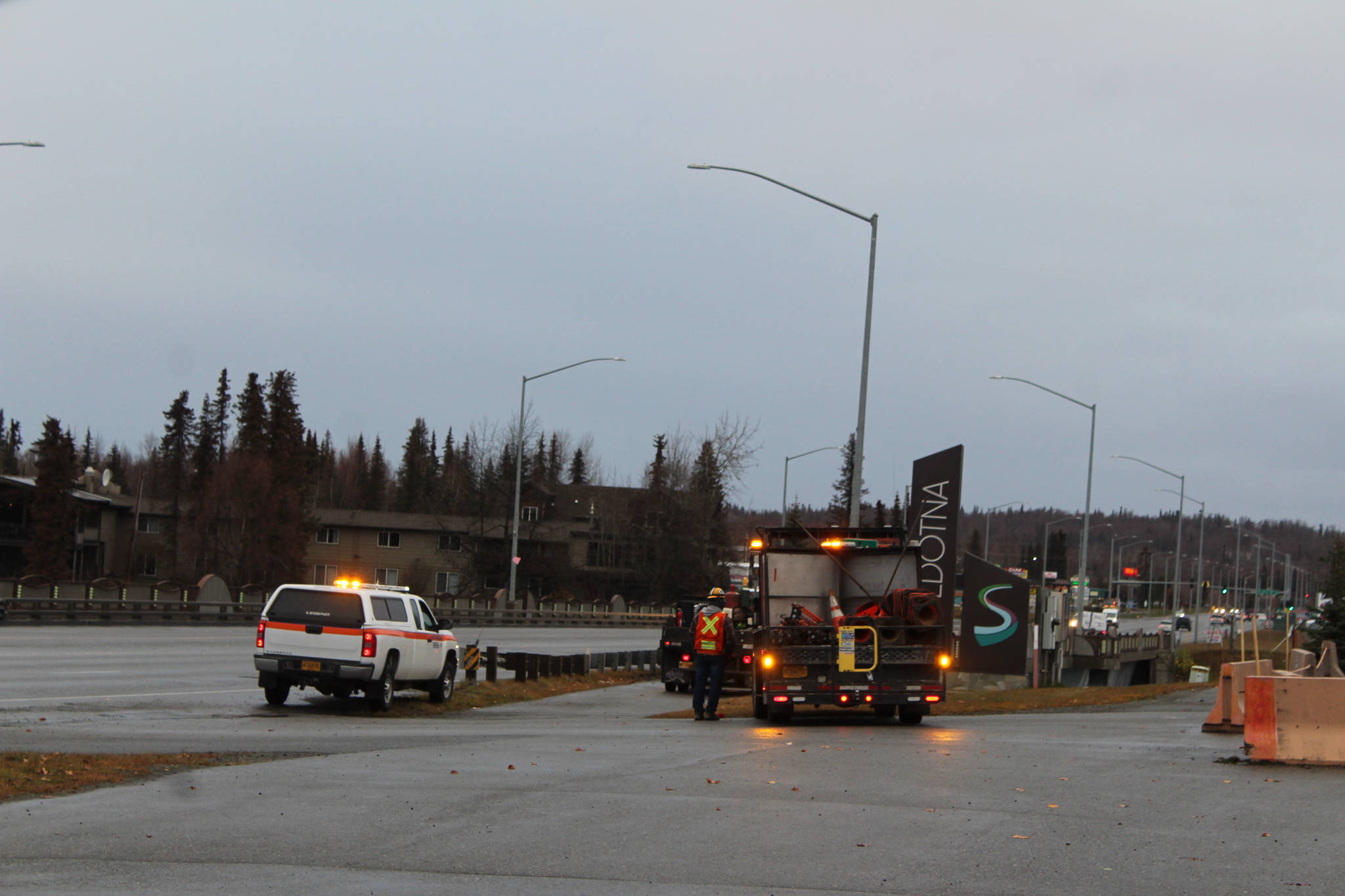 Crews work along the Sterling Highway over the Kenai River on Monday in Soldotna. (Photo by Ashlyn O'Hara/Peninsula Clarion)