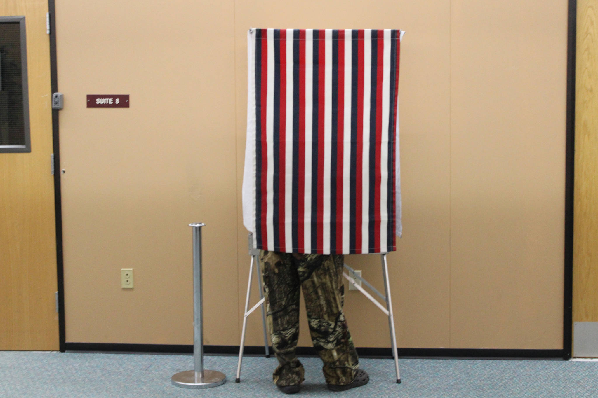 A man votes takes advantage of early voting at the Mendenhall Mall on Oct. 22, 2020. The FBI issued public guidance ahead of the General Election warning voters about what is and isn't federal election crime, and how to report such crimes if they're spotted. (Ben Hohenstatt / Juneau Empire)
