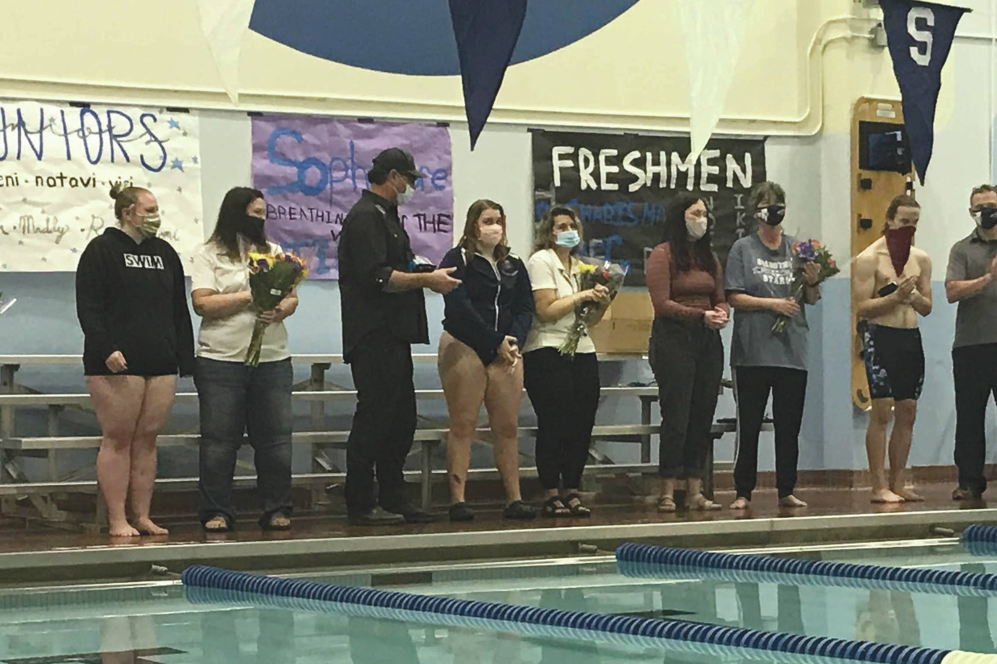 Soldotna High School senior swimmers are honored Oct. 30, 2020, at Soldotna High School. The seniors, from left to right, are Nathan Pitka, Emma Snyer, Deloma Watkins, Kat Gross and Brandon Christenson. (Photo provided by Luke Herman)