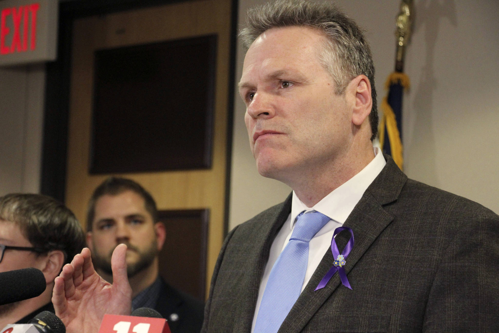 In this March 12, 2020 file photo, Alaska Gov. Mike Dunleavy speaks during a news conference in Anchorage, Alaska. Dunleavy faces criticism for his handling of COVID-19, from those who think he's not doing enough to address rising case counts to those who think he's been overreaching. (AP Photo/Mark Thiessen, File)