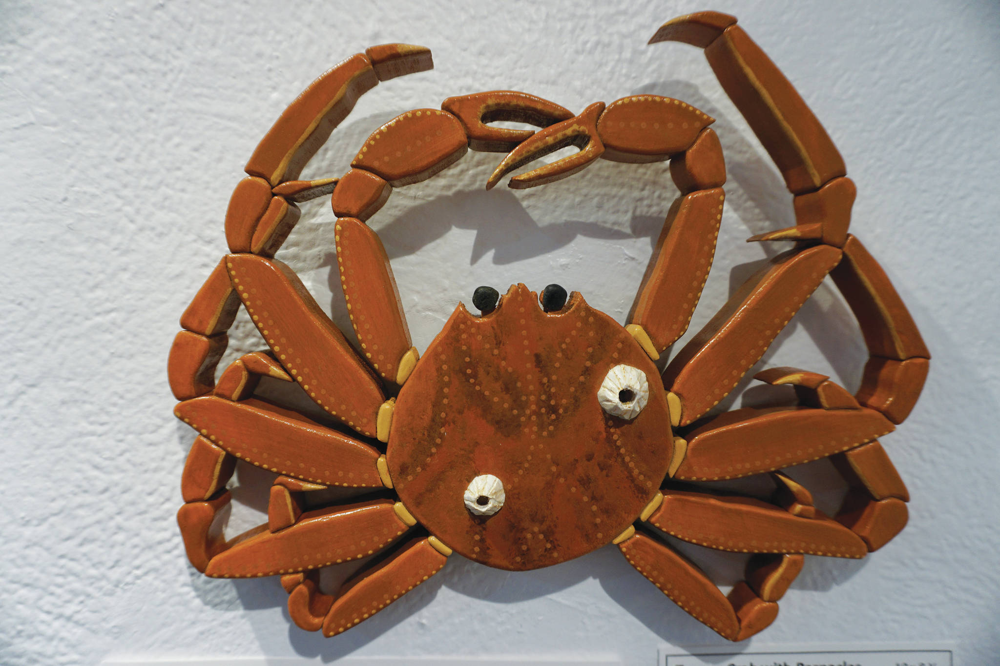 "Michael Armstrong / Homer News ""Tanner Crab with Barnacles"" is one of the wood sculptural pieces in Kim Schuster's exhibit, ""Science Observed Through Art: Unsung Species,"" as seen on Friday at Ptarmigan Arts in Homer."