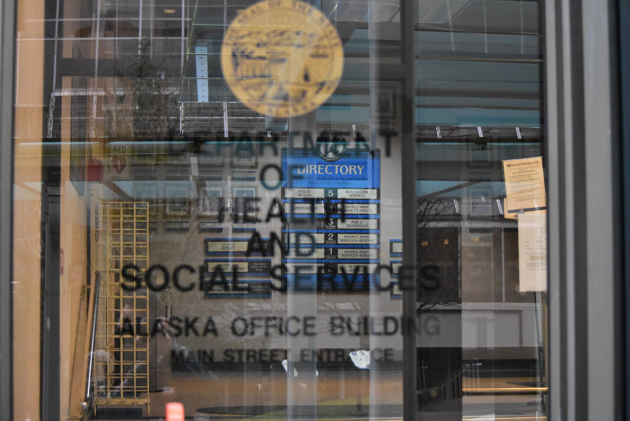 The entrance to the Alaska Department of Health and Social Services building in downtown Juneau. Gov. Mike Dunleavy has proposed splitting the department to spread the administrative burden, but health care workers and tribal leaders say they weren't consulted and Alaska Natives will likely be negatively impacted. (Peter Segall / Juneau Empire)