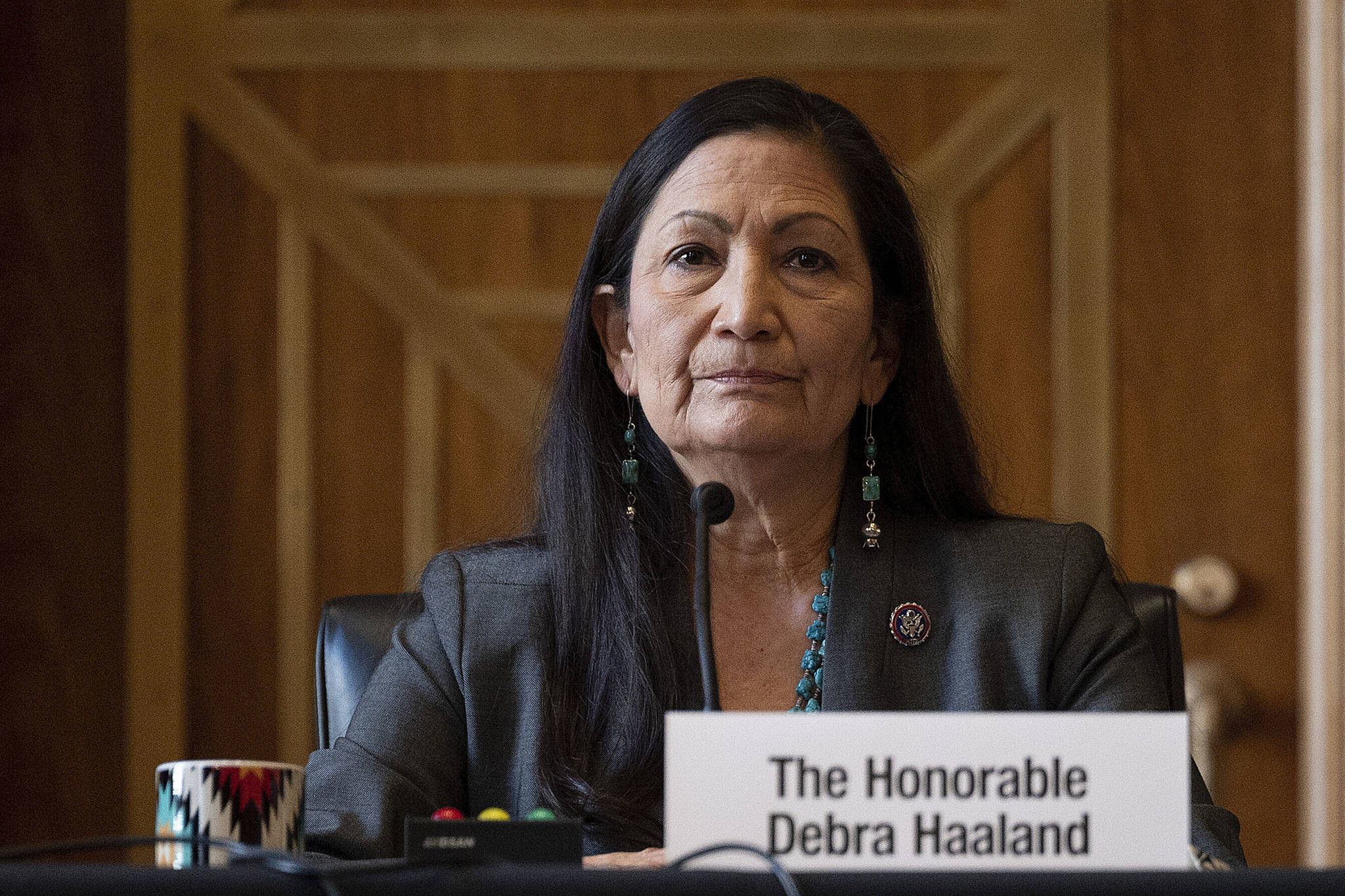 "Rep. Deb Haaland, D-N.M., listens during the Senate Committee on Energy and Natural Resources hearing on her nomination to be Interior secretary, on Capitol Hill in Washington. Some Republican senators labeled Haaland ""radical"" over her calls to reduce dependence on fossil fuels and address climate change, and said that could hurt rural America and major oil and gas-producing states. The label of Haaland as a ""radical"" by Republican lawmakers is getting pushback from Native Americans. (Jim Watson / Pool Photo)"