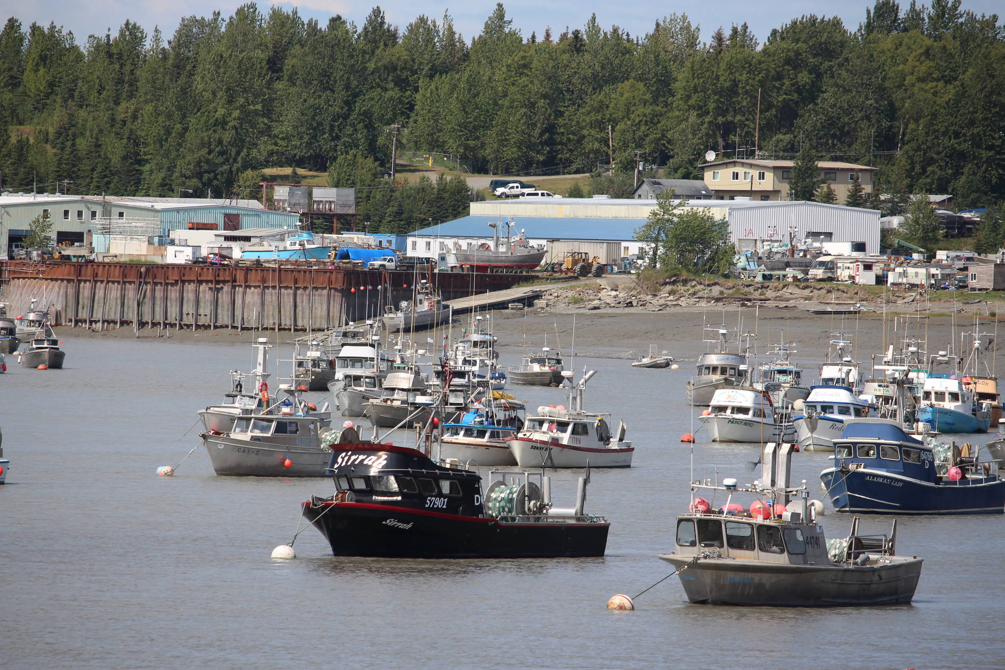 Commercial fishing vessels are moored at the mouth of the Kenai River on July 10, 2020. (Photo by Brian Mazurek/Peninsula Clarion)