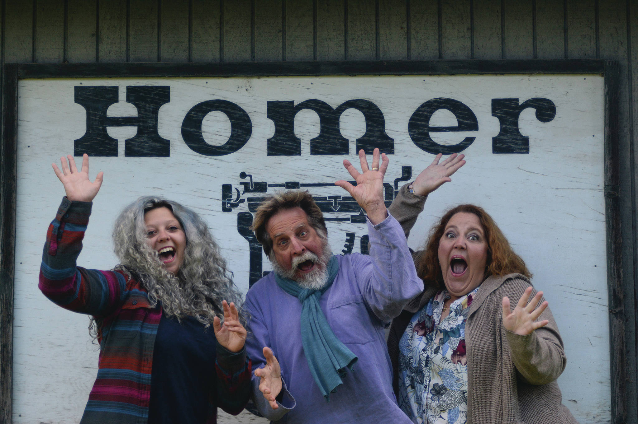The author (left) enjoys taking a corporate photo with Editor Michael Armstrong (center) and advertising rep Malia Anderson (right) at the Homer News office in Homer, Alaska. (Photo by Michael Armstrong/Homer News)