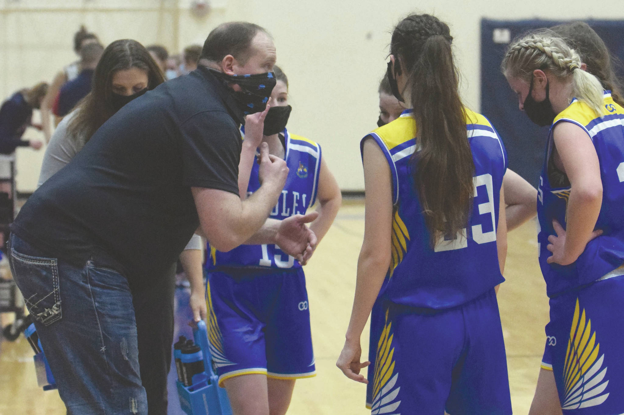 Cook Inlet Academy girls head coach Josh Hawley coaches at the Peninsula Conference tournament Friday, March 19, 2021, at Soldotna High School in Soldotna, Alaska. (Photo by Jeff Helminiak/Peninsula Clarion)