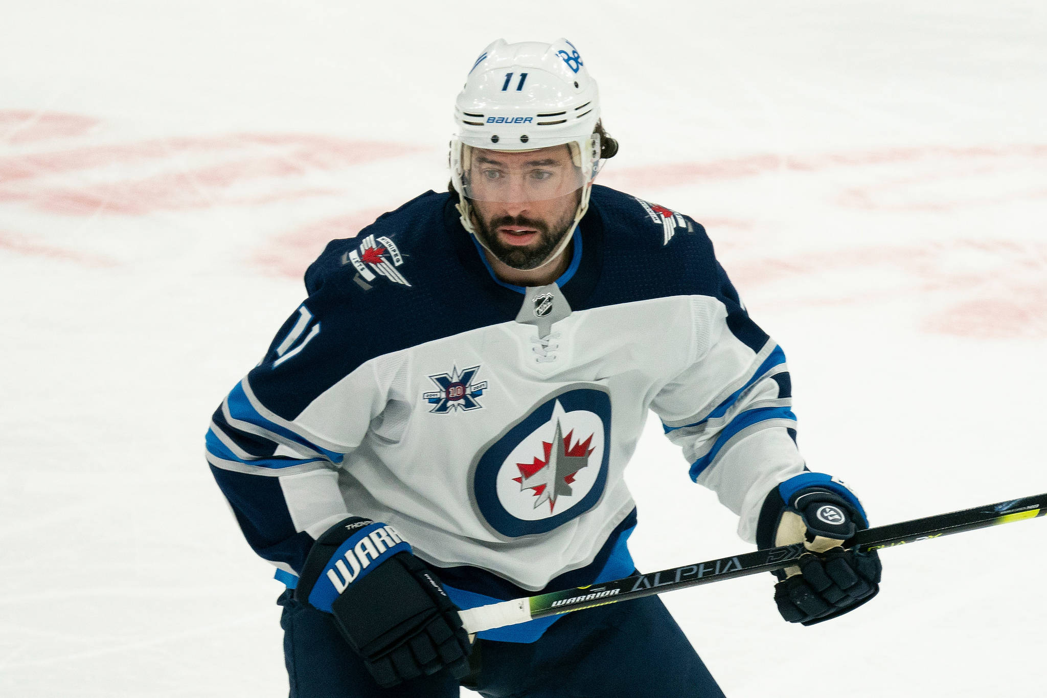 Winnipeg Jets center Nate Thompson (11) during an NHL hockey game against the Toronto Maple Leafs on Thursday, April 15, 2021, in Toronto, Canada. (AP Photo/Peter Power)