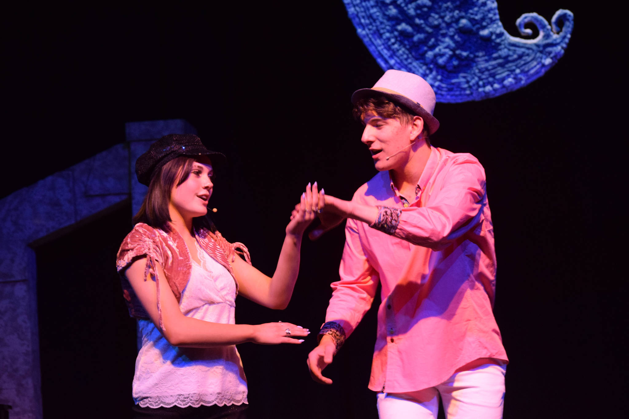 """Shylea Freeman (left) and Dwyght Mullins sing onstage as their characters Sharpay and Ryan Evans in the Nikiski Middle/High School's spring production of """"High School Musical"""" in Nikiski, Alaska, on Wednesday May 5, 2021. (Camille Botello / Peninsula Clarion)"""