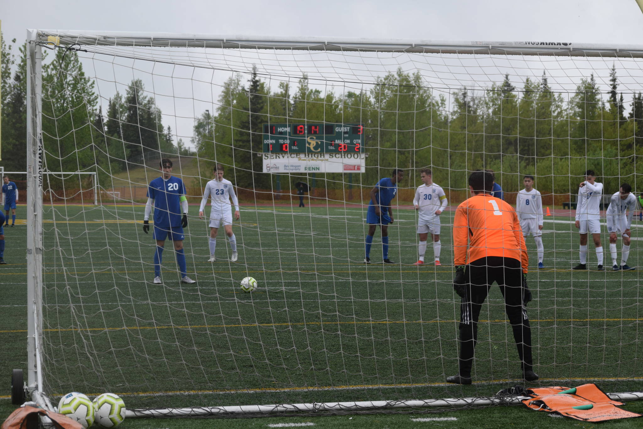 Josh Hieber lines up a penalty kick during the state championship game in Anchorage, Alaska on Saturday, May 29, 2021. (Camille Botello / Peninsula Clarion)
