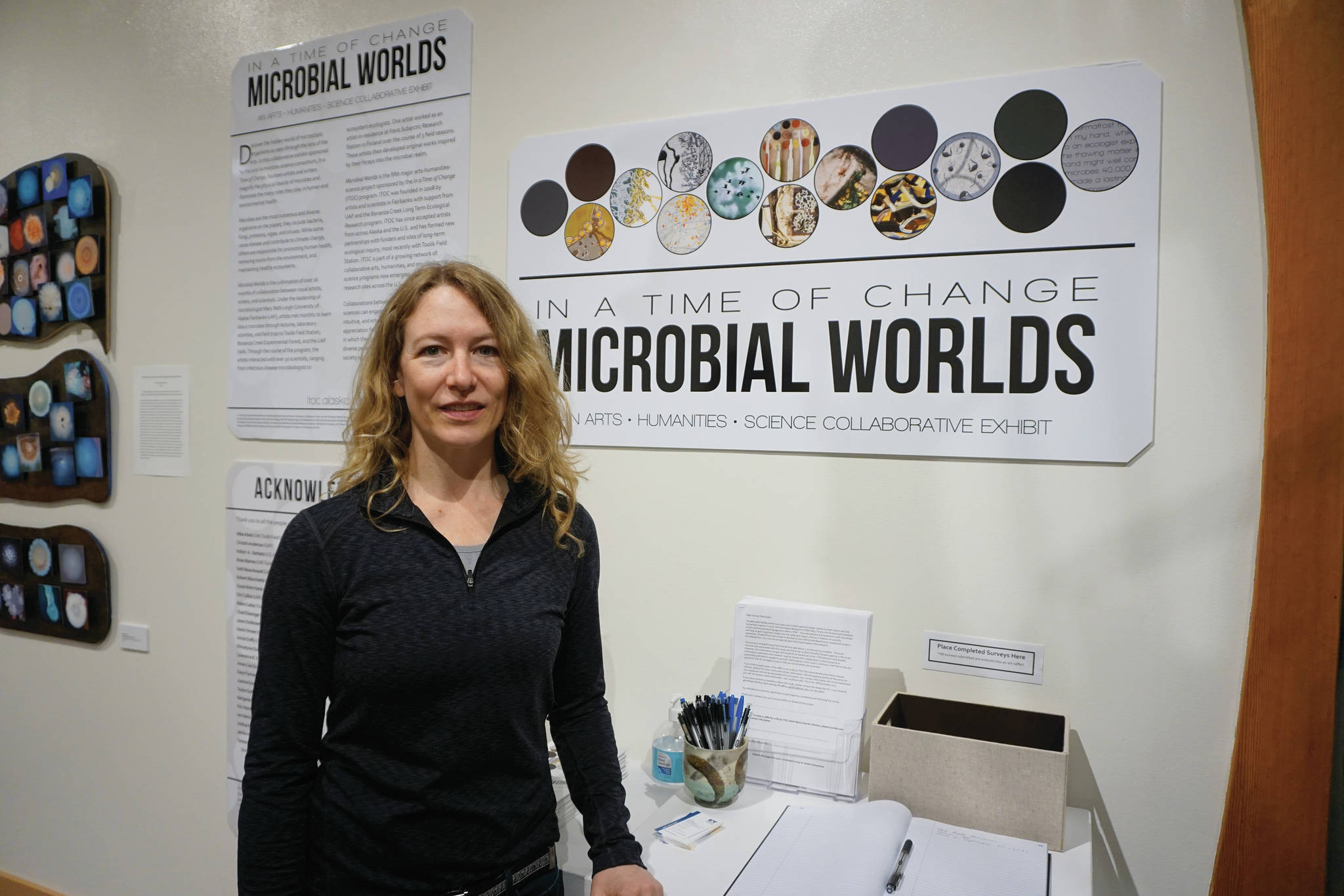 Mary Beth Leigh, director of the Microbial Worlds project, stands next to the exhibit on Friday, June 4, 2021, at the Pratt Museum & Park in Homer. The exhibit shows through the summer of 2021. (Photo by Michael Armstrong/Homer News)