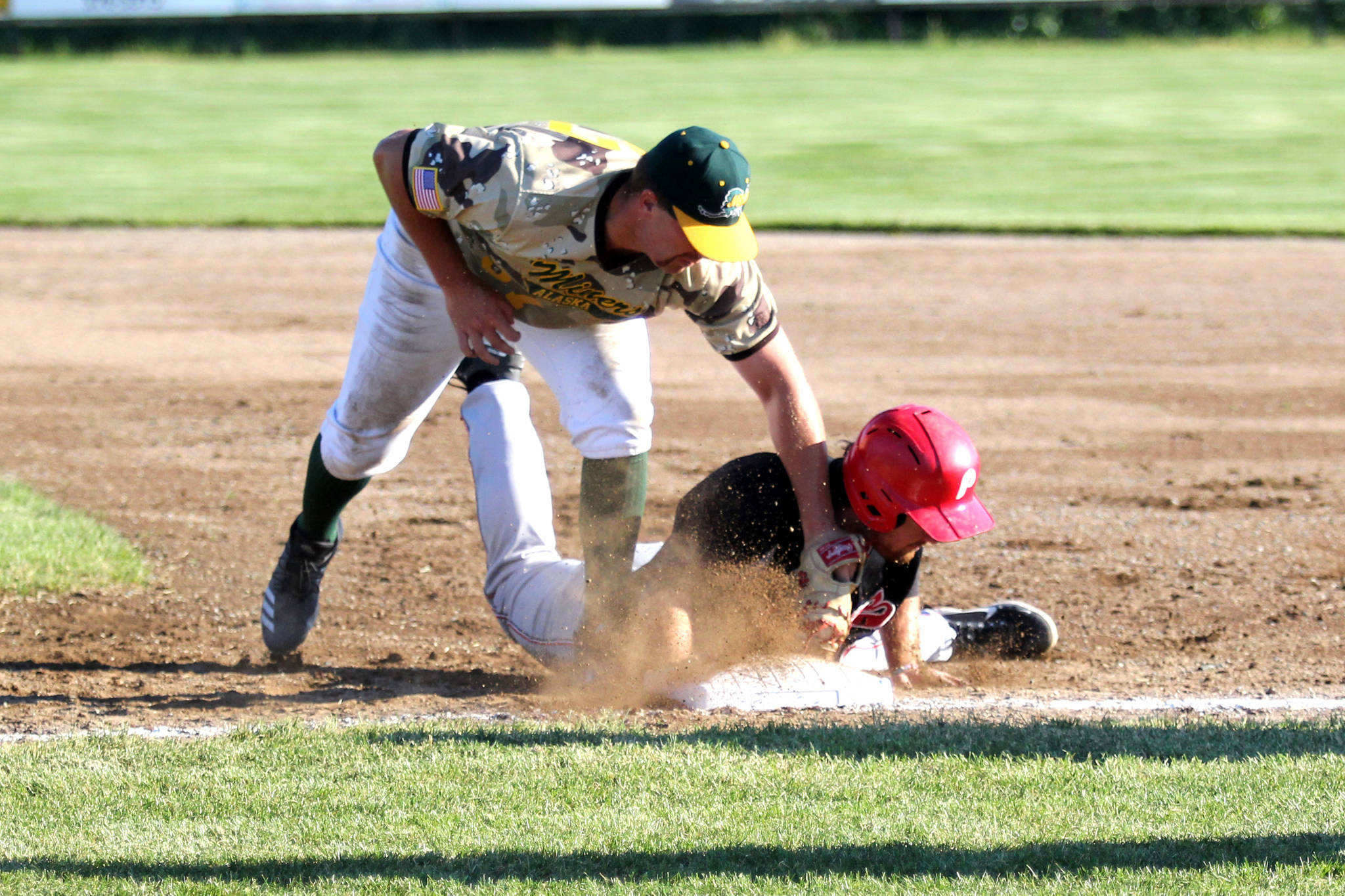 Peninsula Oilers first baseman John Hanley beats the tag of Mat-Su Miners first baseman Nick Cirelli during Mat-Su's 5-2 win over the Oilers Monday, June 14, 2021, at Hermon Brothers Field in Palmer. (Jeremiah Bartz/Frontiersman)