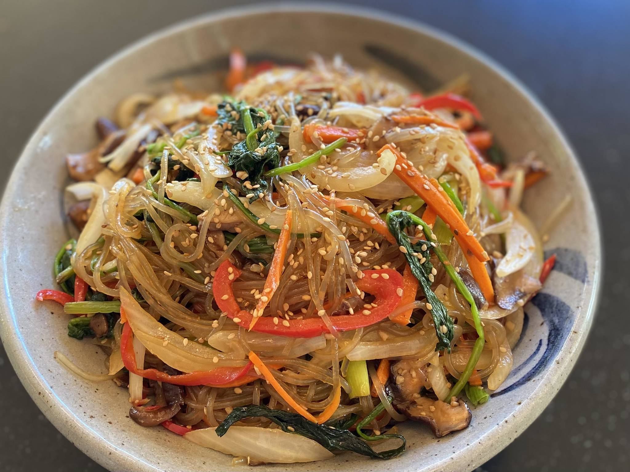 Containing onions, carrots, shitake mushrooms and noodles Japchae is a stir-fried Korean vegetable and noodle dish that is delectable hot, cold and everywhere in between. (Photo by Tressa Dale/Peninsula Clarion)