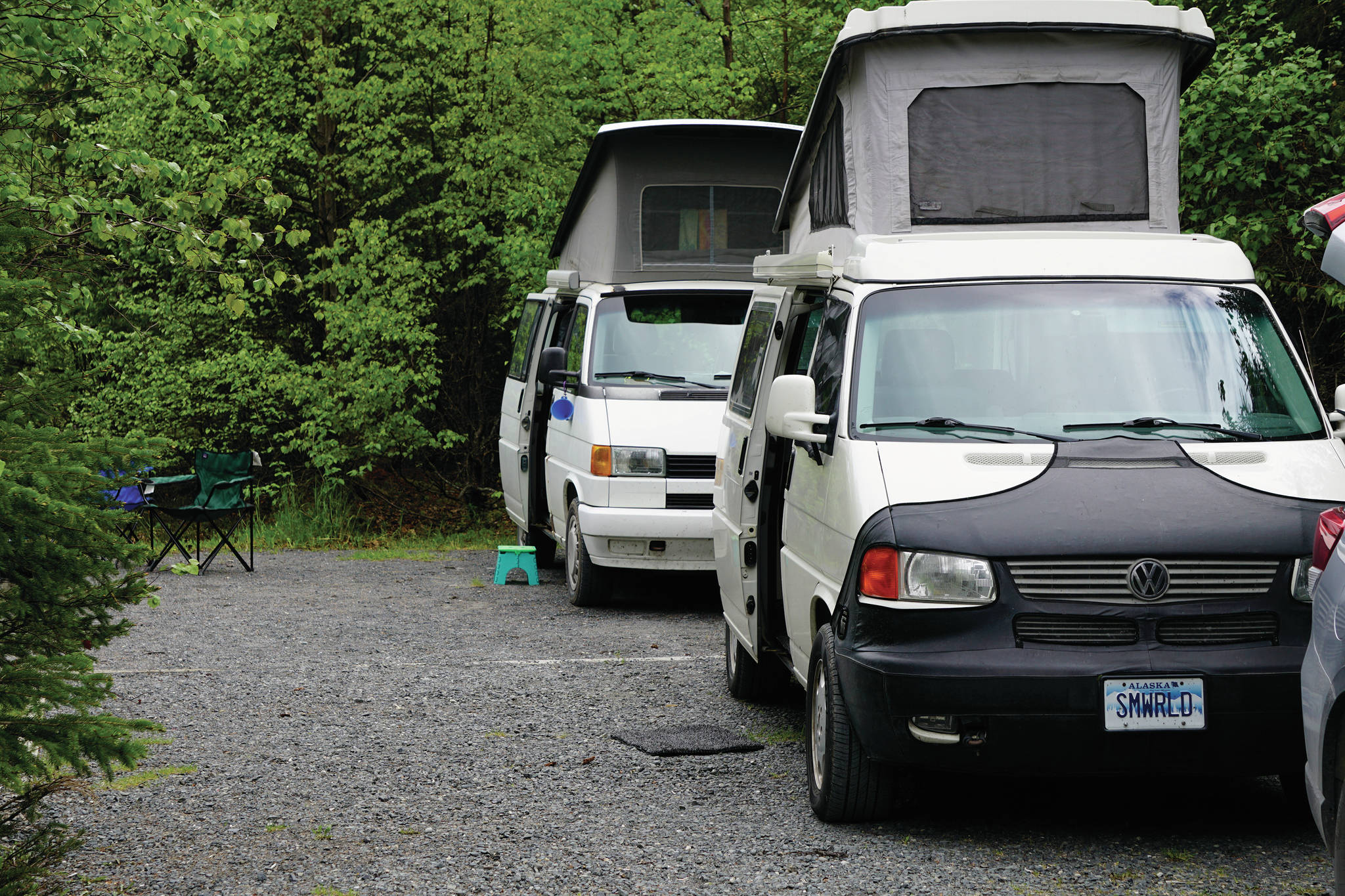 Two vintage VW campers are seen on Thursday, June 10, 2021, at the Trail River Campground near Seward, Alaska. (Photo by Michael Armstrong/Homer News)