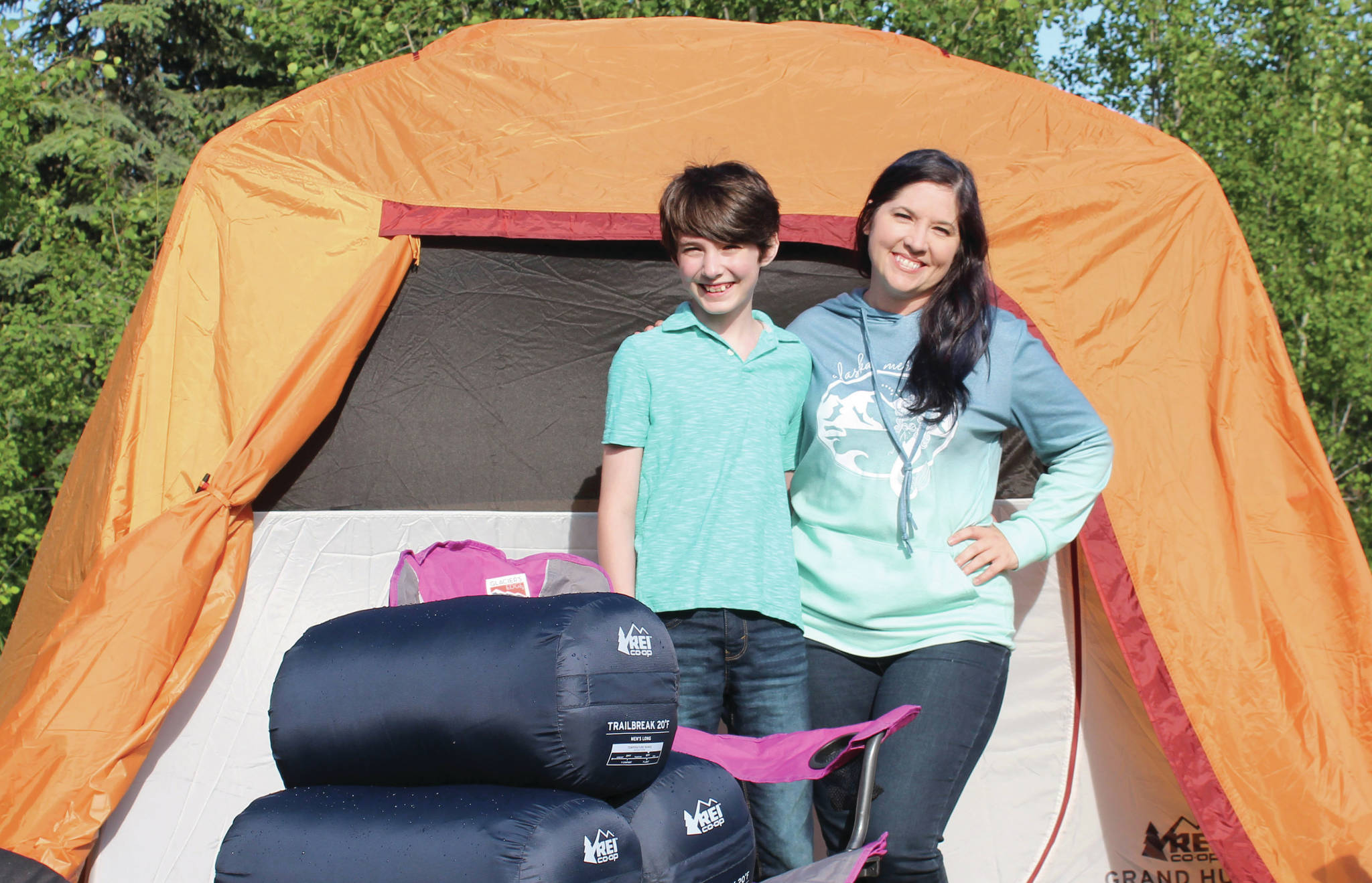 Ashlyn O'Hara / Peninsula Clarion  Koebryn and Summer Lazenby stand in front of camping gear Tuesday at Summer's house near Soldotna.