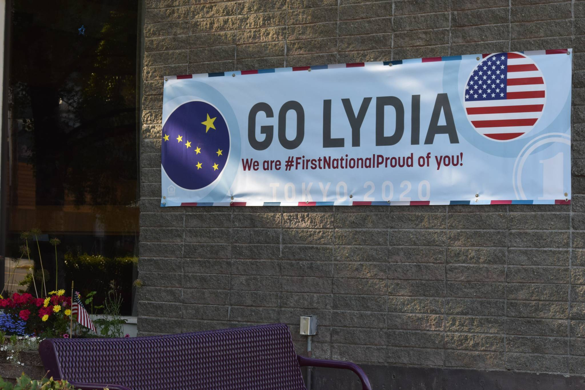 A banner supporting Olympic swimmer Lydia Jacoby hangs outside of First National Bank Alaska in her hometown of Seward on Saturday, July 24, 2021. (Camille Botello/Peninsula Clarion)