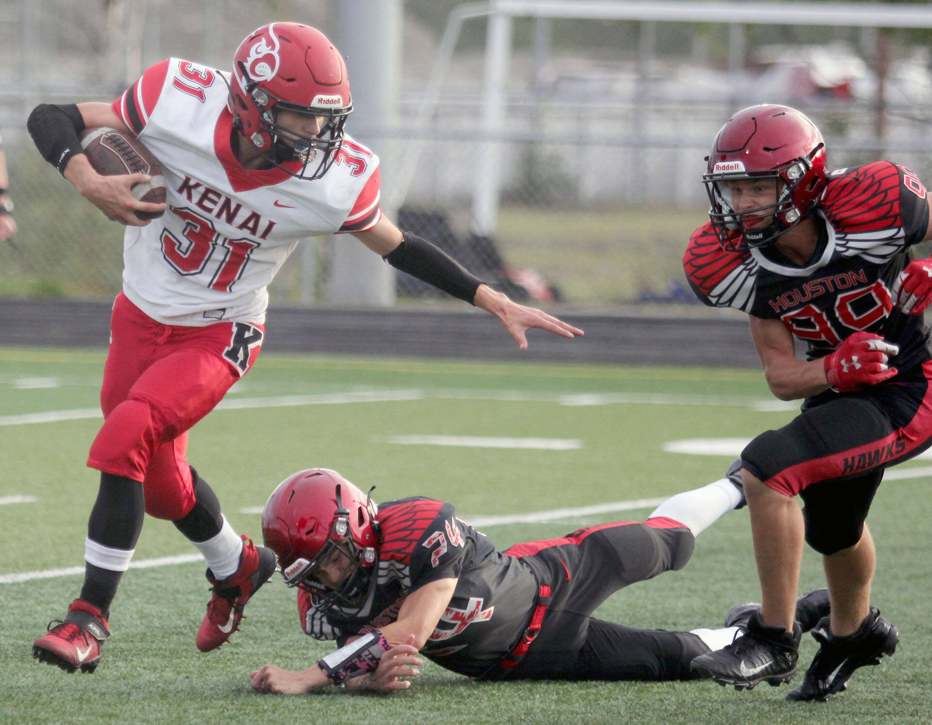 Kenai's Levi Good tries to break outside during a 32-2 loss to the Houston Hawks on Friday, Sept. 3, 2021, in Houston, Alaska. (Photo by Jeremiah Bartz/Frontiersman)