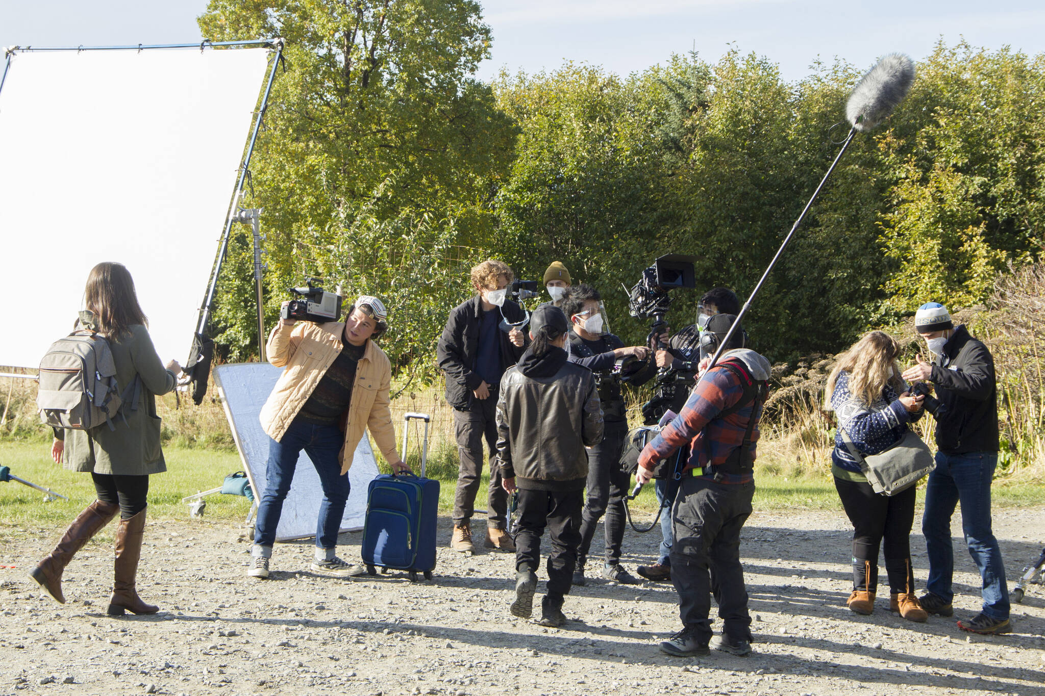 """The Cosmic Hamlet Entertainment film crew and actors reset for a scene on the set of """"Bolt from the Blue"""" at the Kilcher Homestead on Sept. 28. (Photo by Sarah Knapp/Homer News)"""