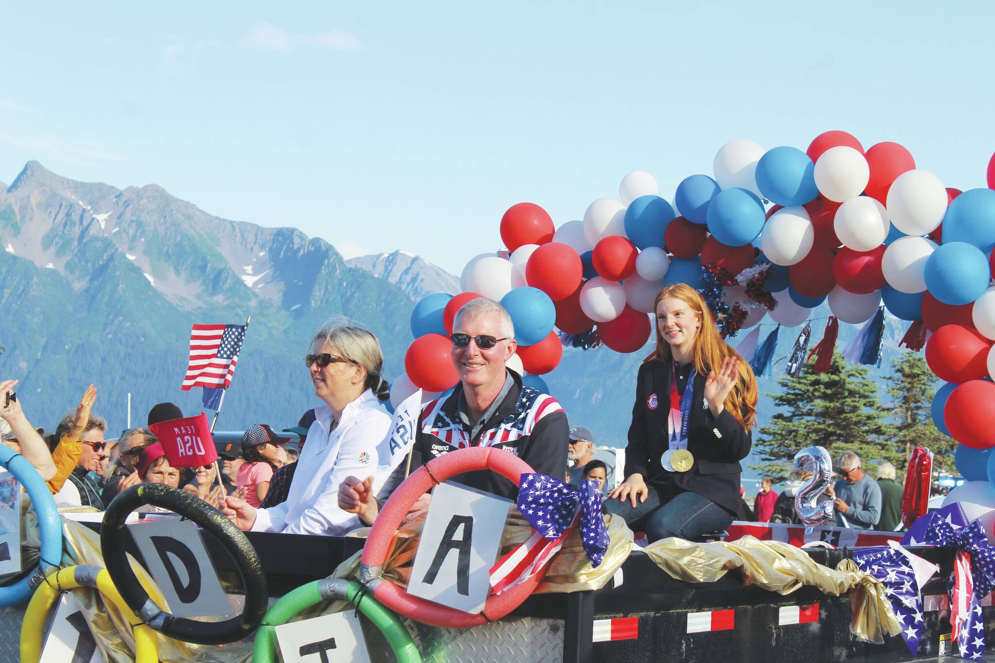 Olympic gold medalist Lydia Jacoby waves to the crowd in Seward during her celebratory parade on Thursday, August 5, 2021. (Ashlyn O'Hara/Peninsula Clarion)