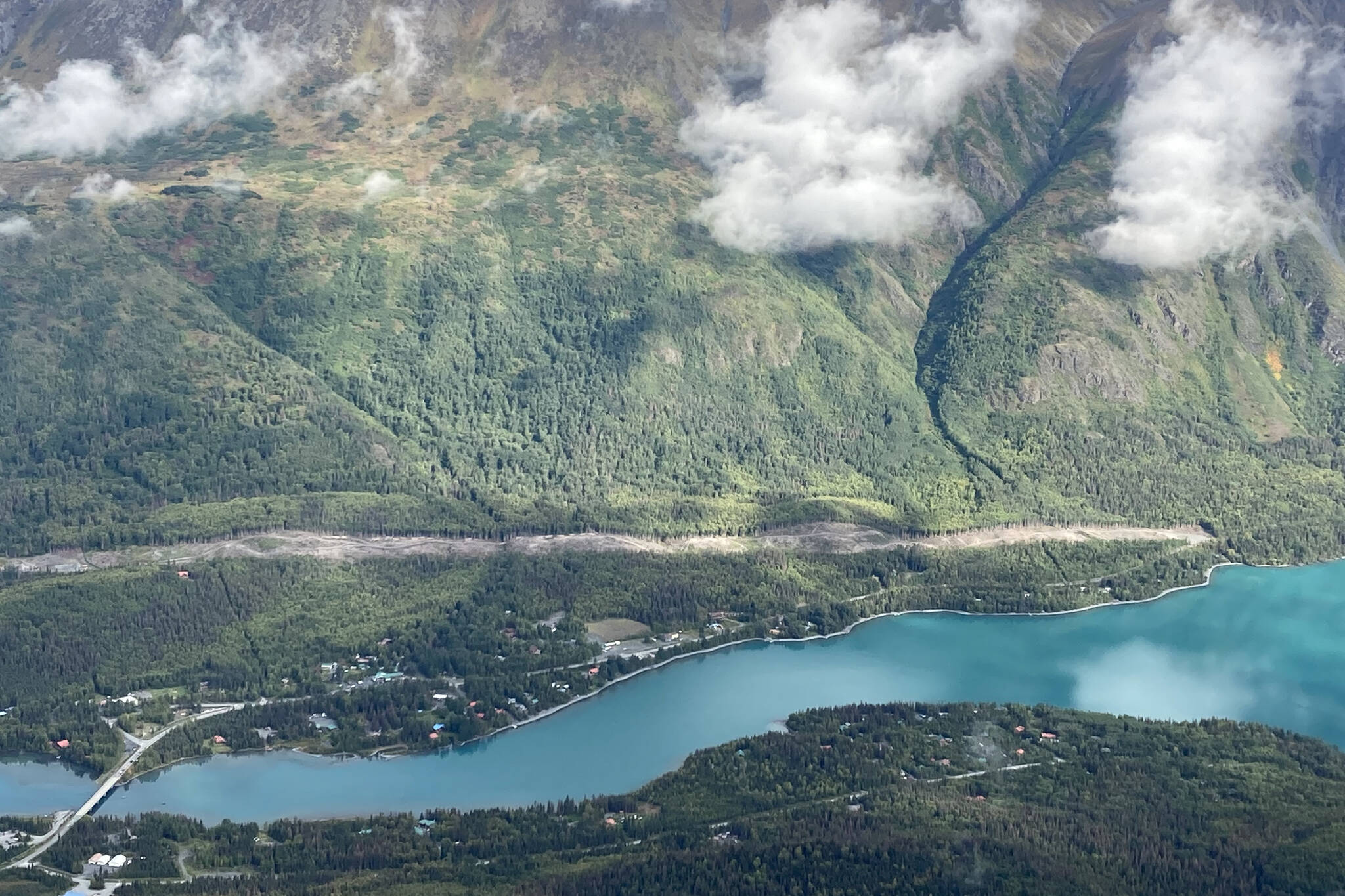 An area cleared to make way for the Cooper Landing Bypass project can be seen above the intersection of the Kenai River and Kenai Lake in Cooper Landing, Alaska, on Sept. 6, 2021. (Photo by Jeff Helminiak/Peninsula Clarion)